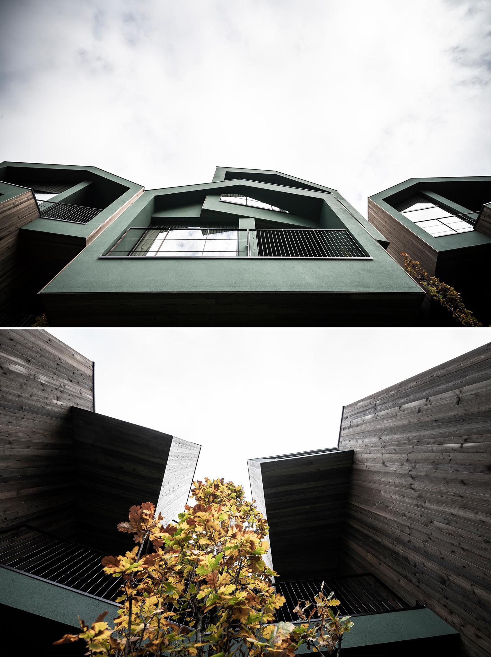 A collection of elevated hotel rooms with wood siding that are designed to look like tree houses.