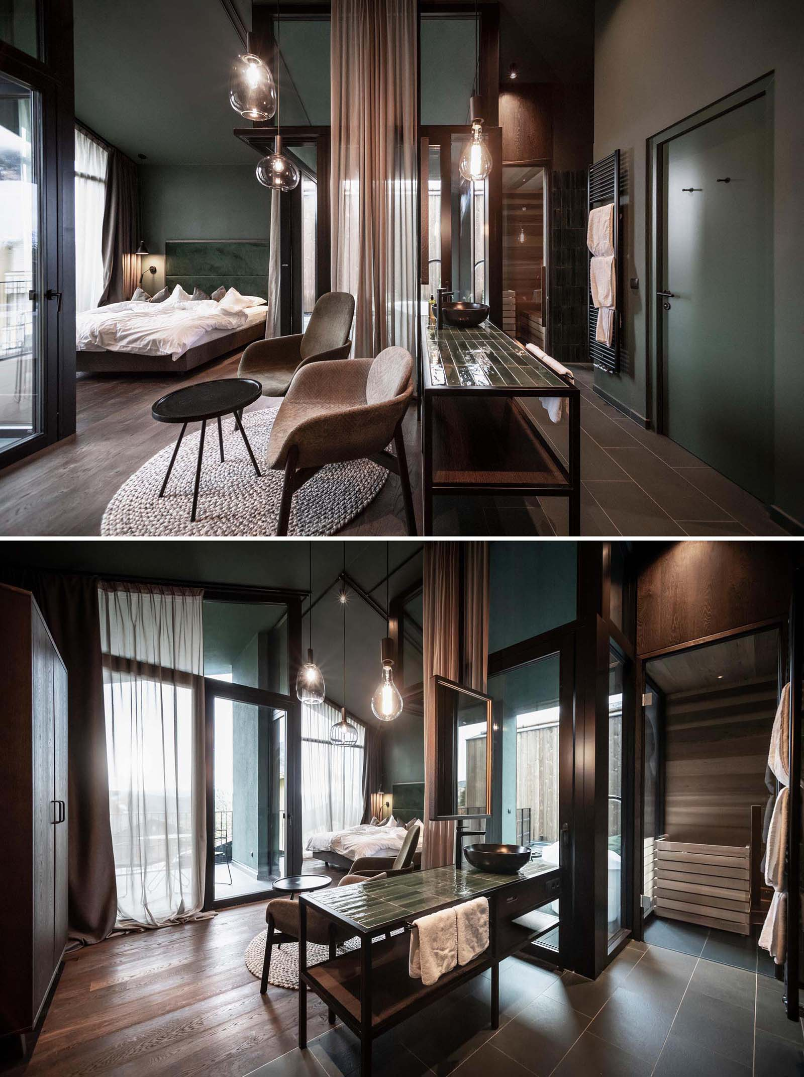 A modern hotel room with an open bathroom, a glass walled bedroom, and outdoor bathtubs.