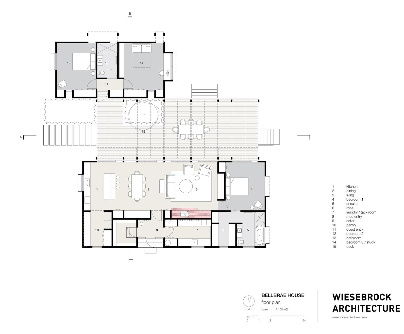The floor plan of a modern home with two separate pavilions and a deck that links them.