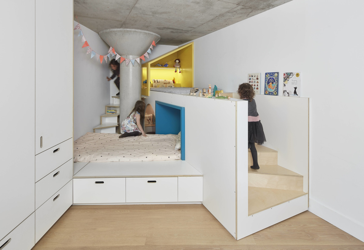 A fun custom-designed bedroom for two small children.