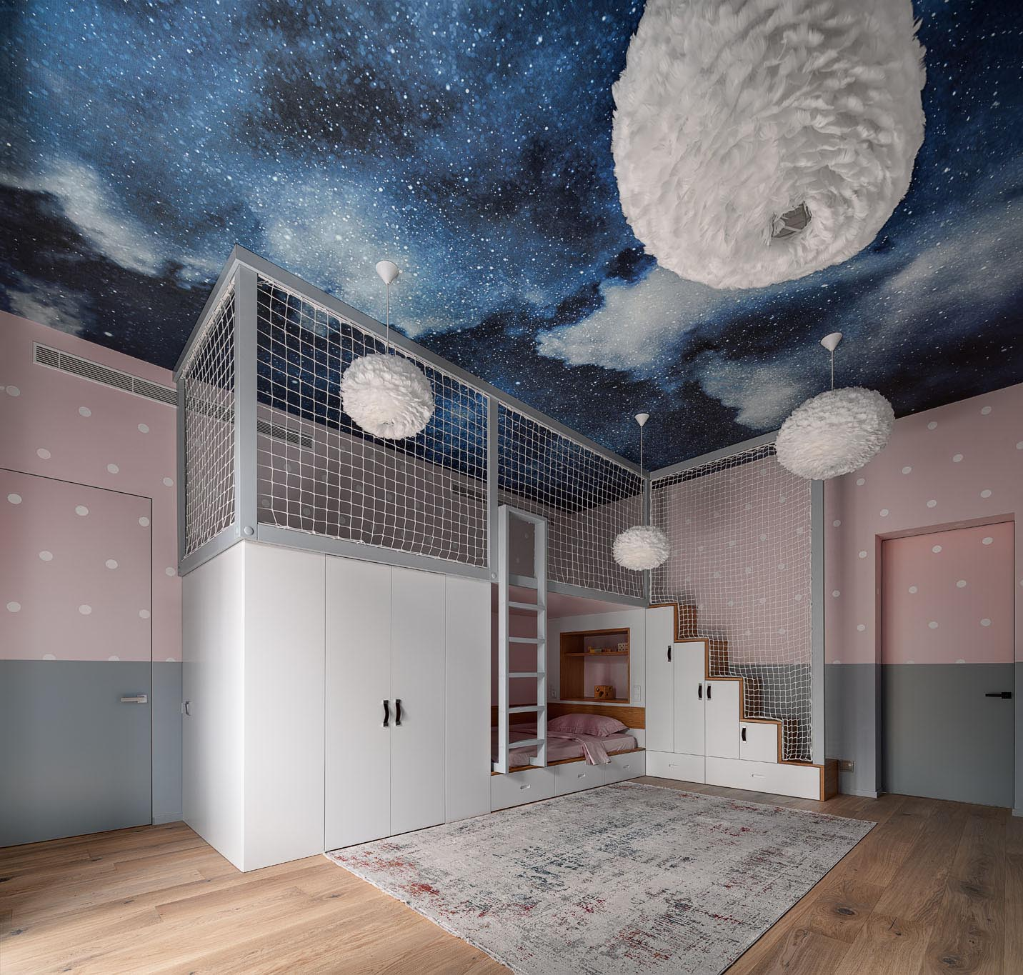 The lower section of this fun kid's bedroom includes stairs with storage and a ladder, both of which provide access to the upper loft level, while netting has been added to the frame for safety.