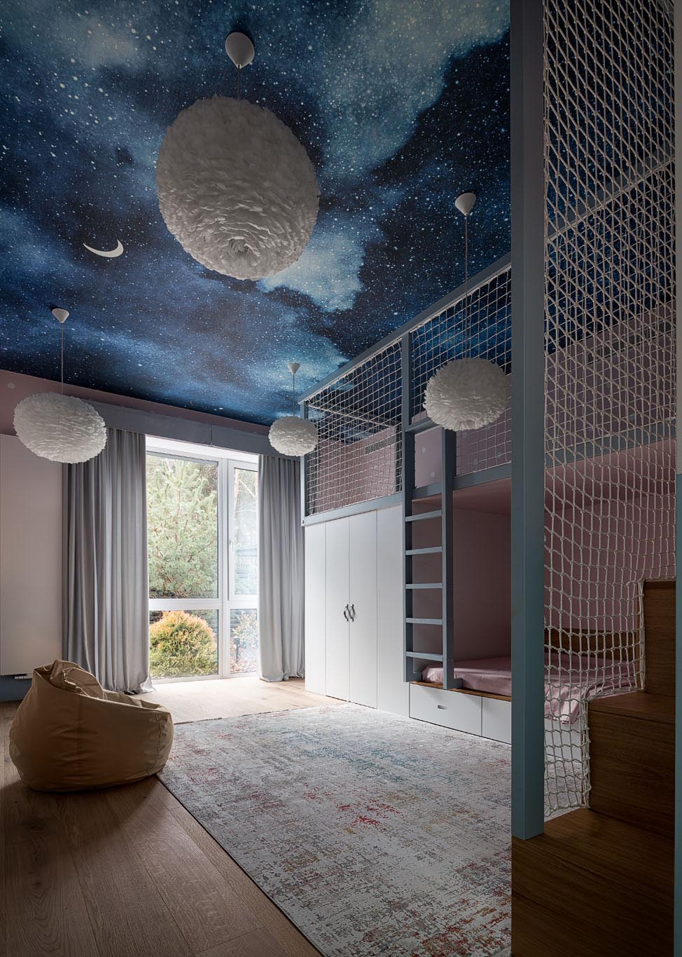 The bedroom ceiling of this kid's room has been decorated with a night sky mural and delicate white pendant lights of different sizes.