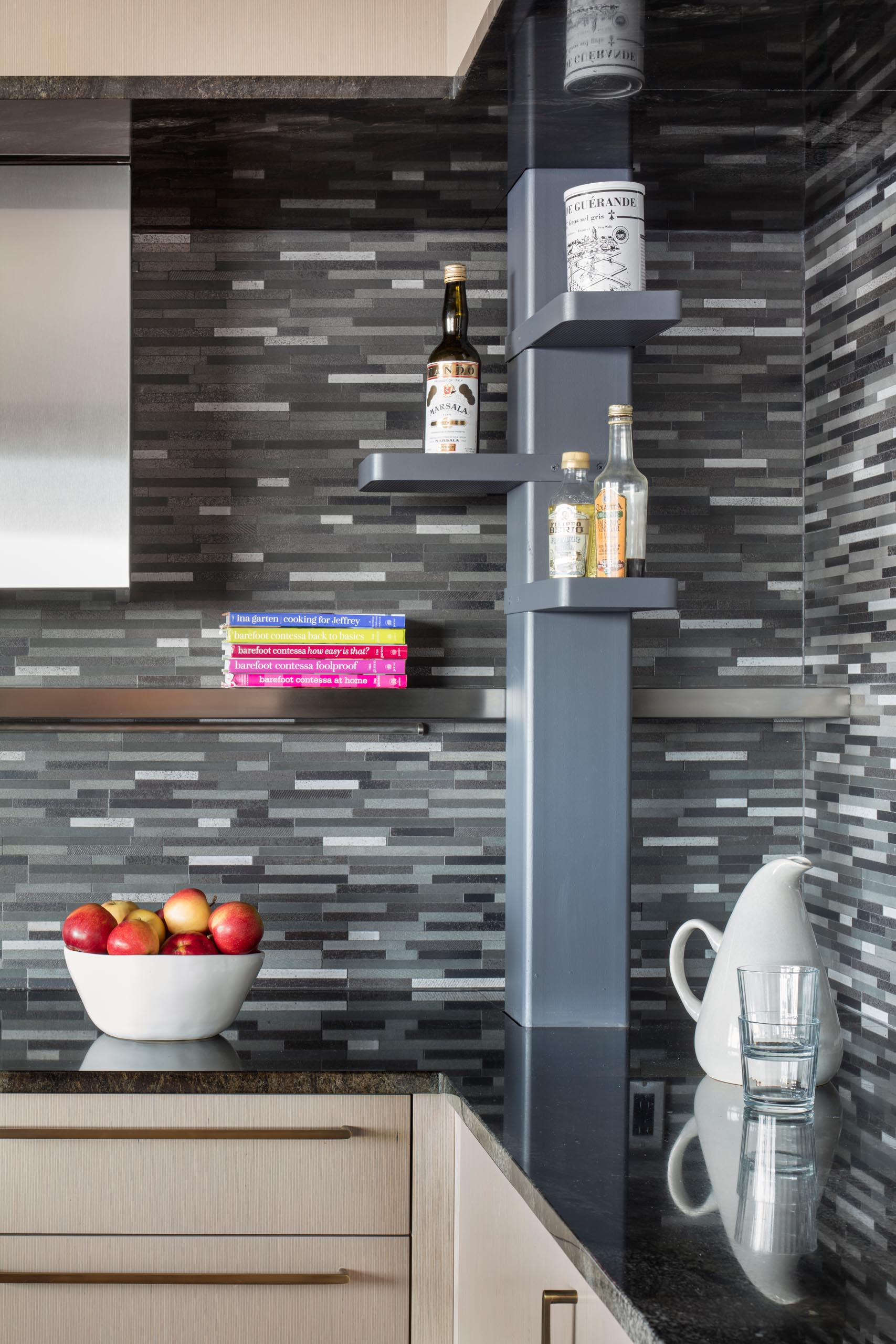 A modern kitchen with a gray tile backsplash.