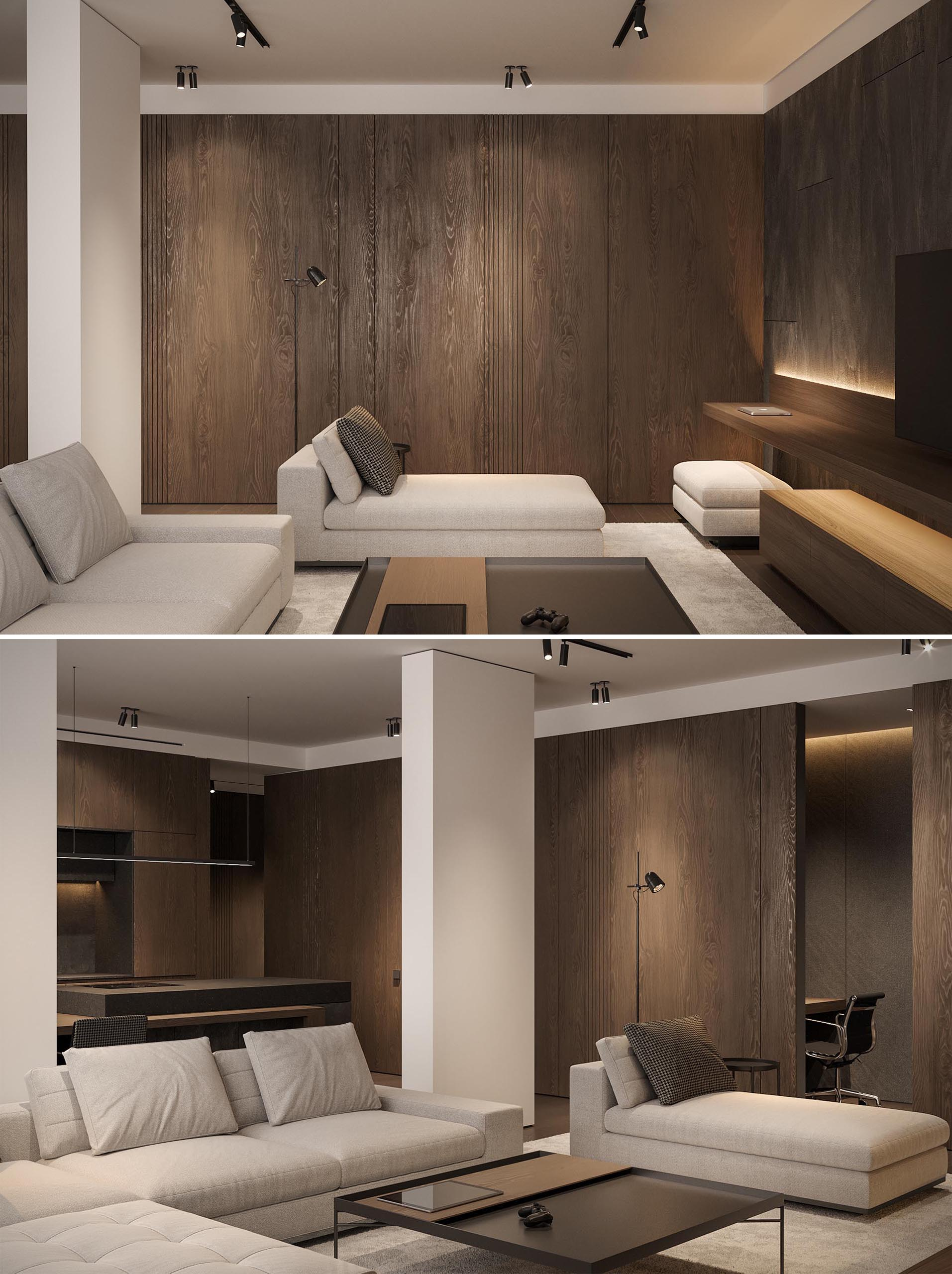 A small home office with a built-in desk is hidden behind a wood panel wall in the living room.