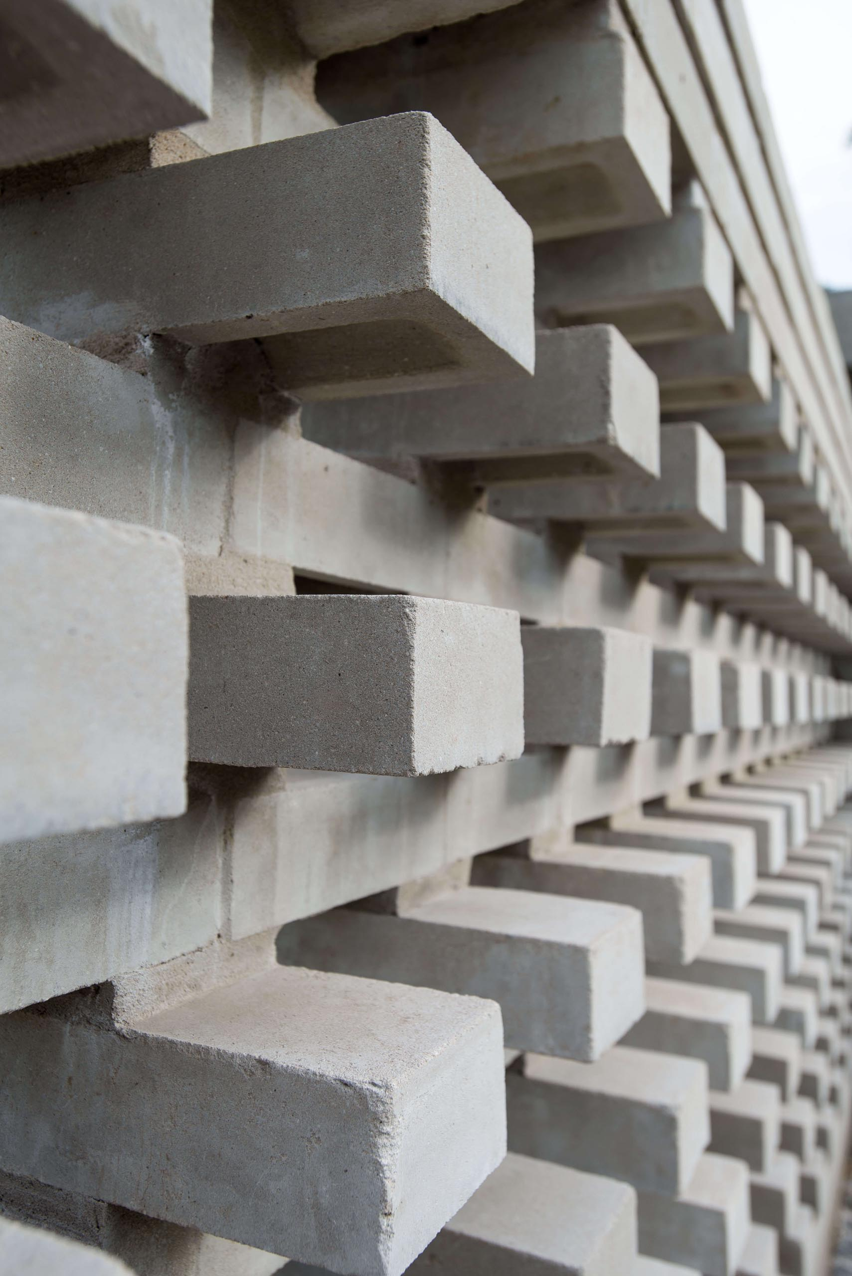 A closeup look at a modern concrete block wall that provides privacy for a home.