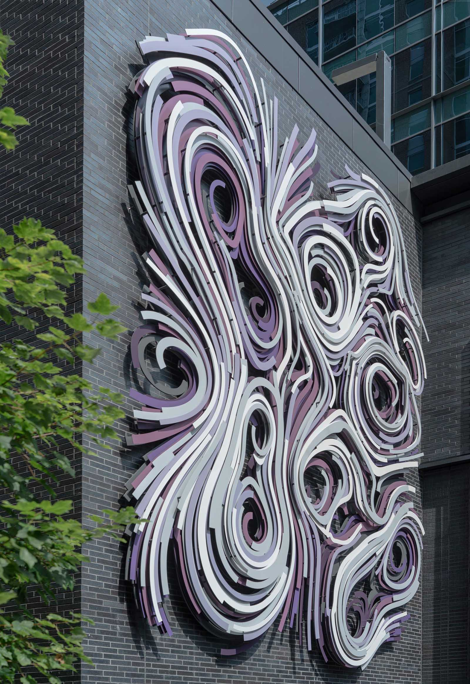 A modern large scale mural on the side of a building.