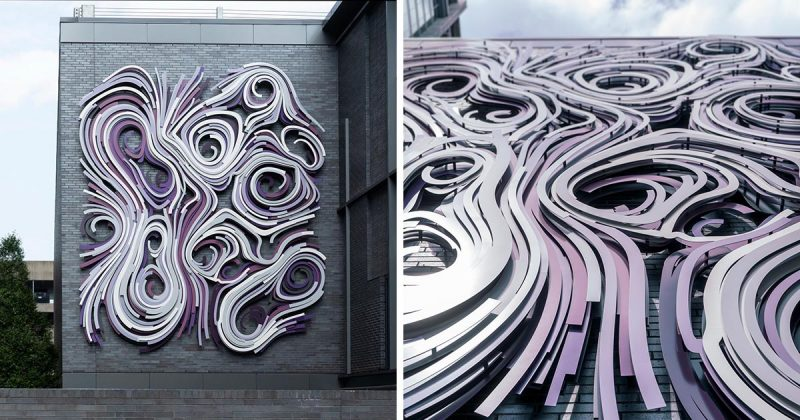 A large art installation on the side of a building.