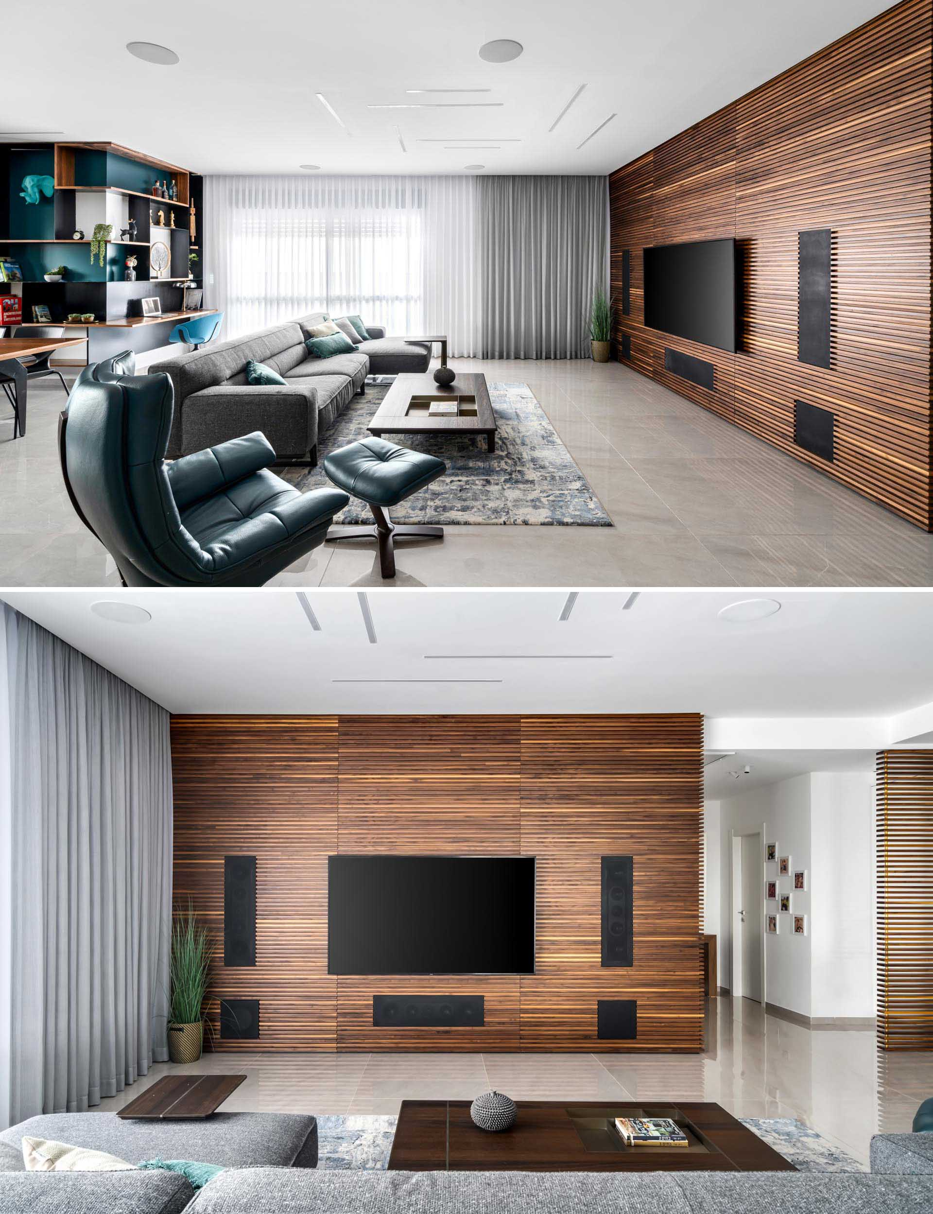In this modern living room, a wood slat accent wall made from walnut becomes the backdrop for the television