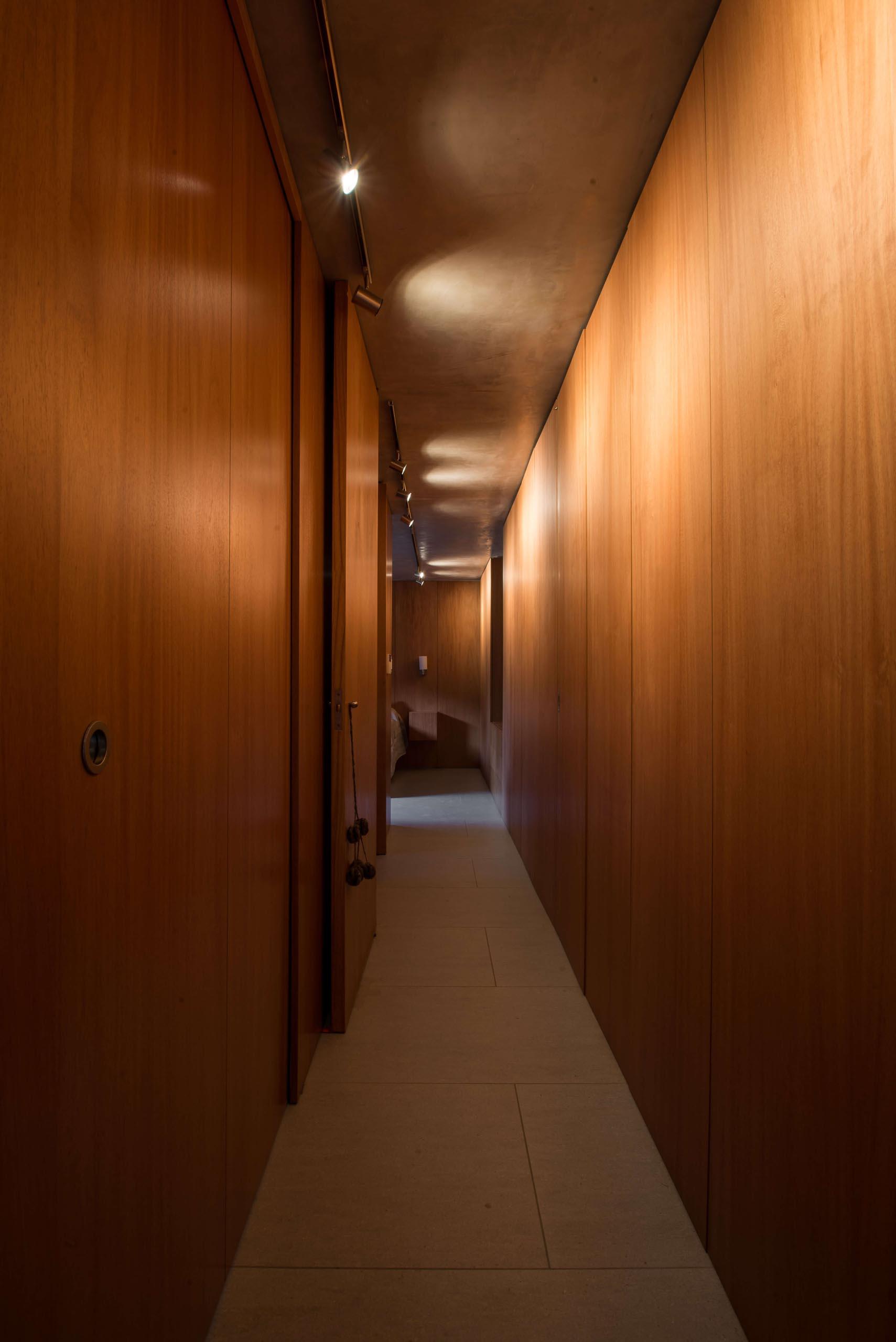 A wood lined hallway.
