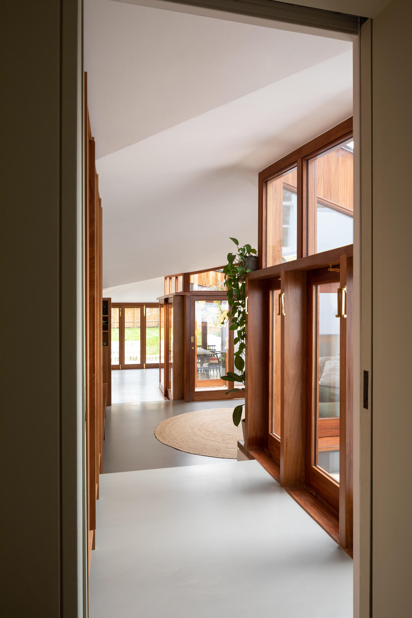 The thick wood window and door frames of a modern extension add a warmth to the interior.