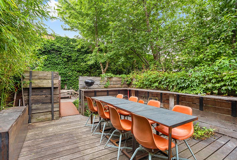 An outdoor dining area surrounded by plants.