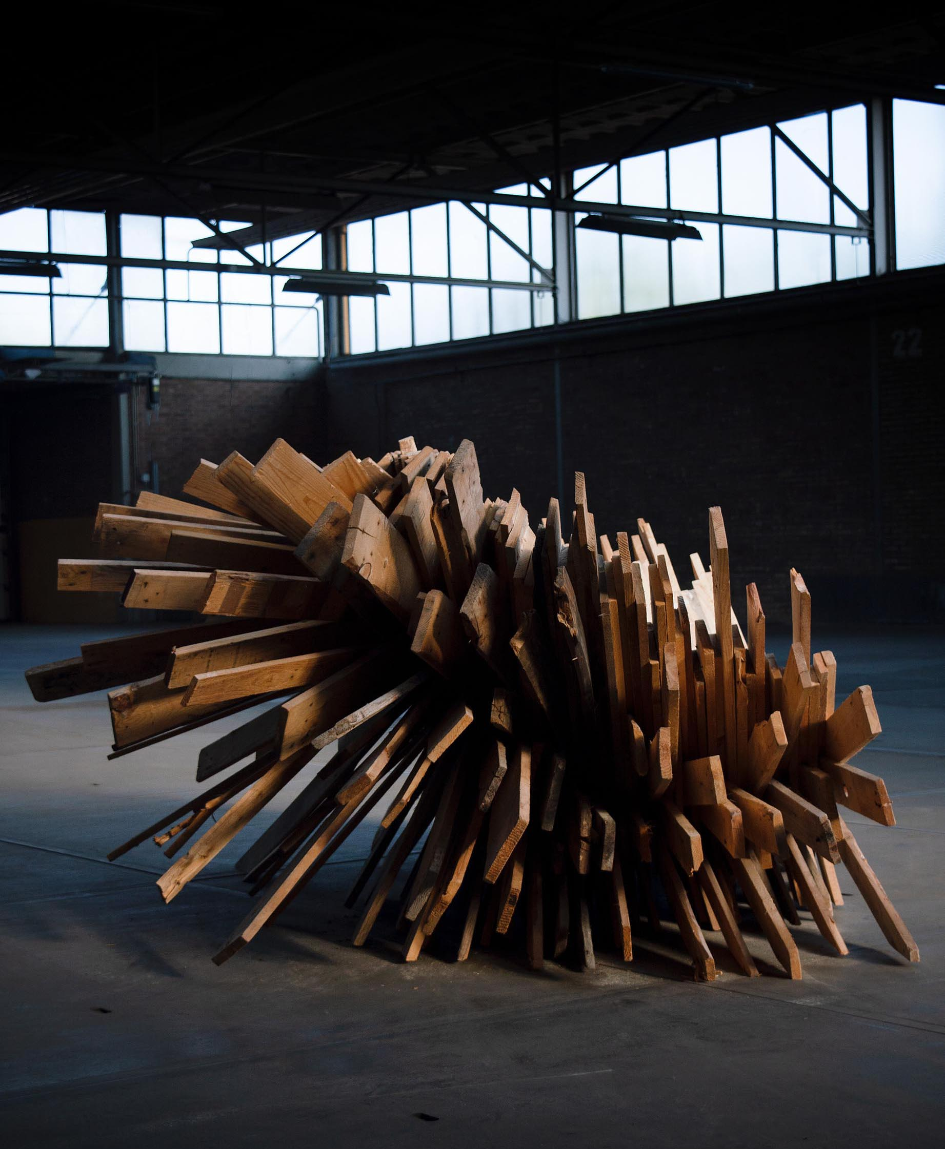 An oversized and sculptural chair made from recycled pallets.