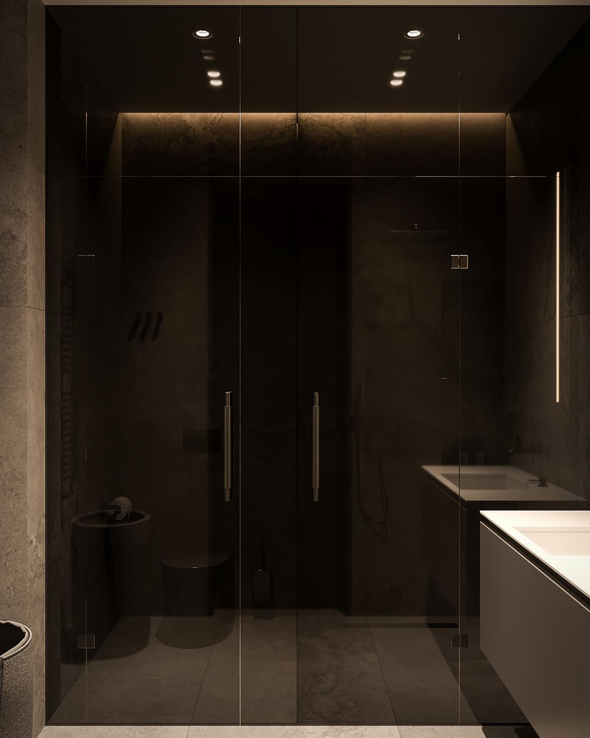 A modern bathroom with a white vanity, large format tiles, and black accents, like a tinted glass shower door.