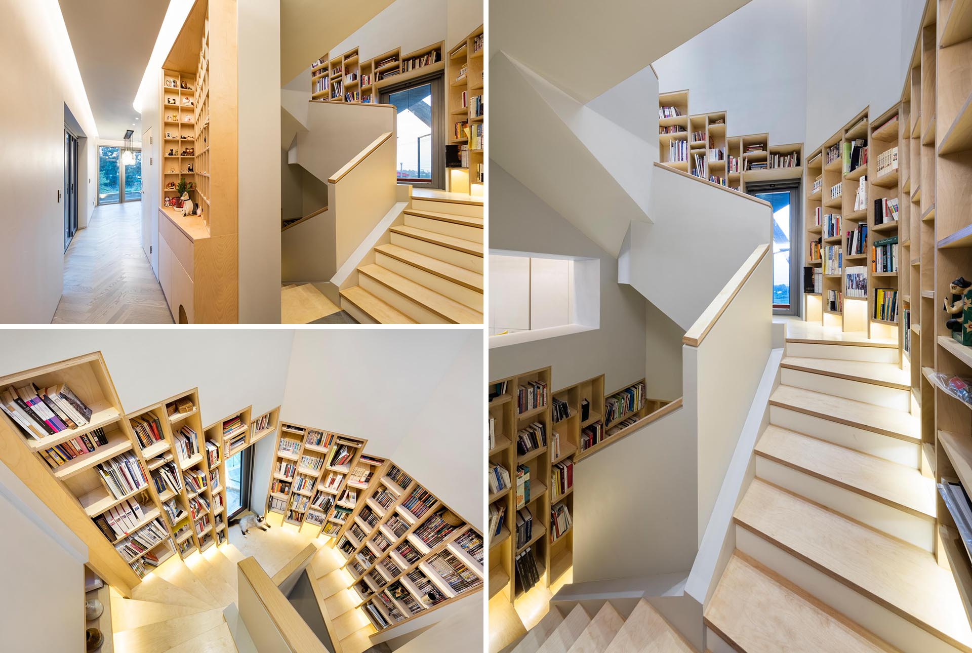 A built-in bookshelf that follows the staircase in a modern home.