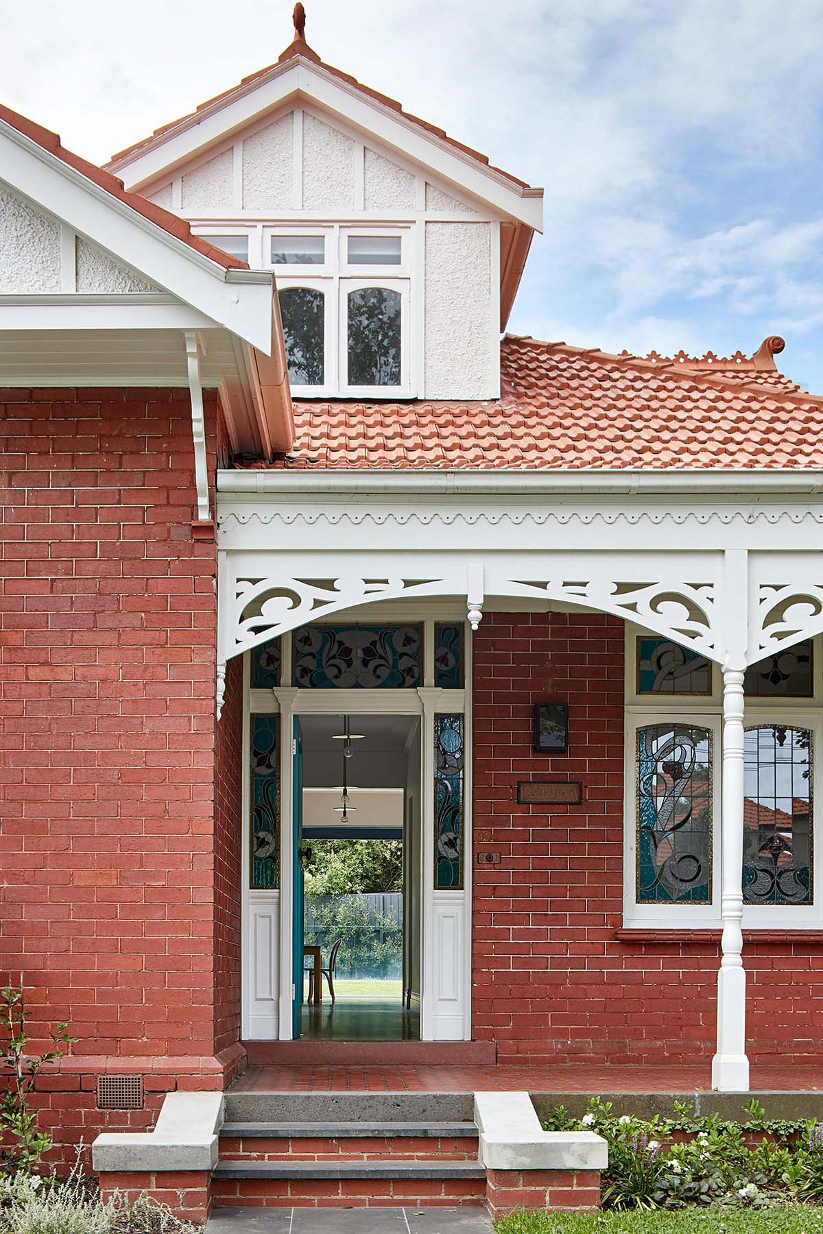 An Australian brick Federation house with a front porch.