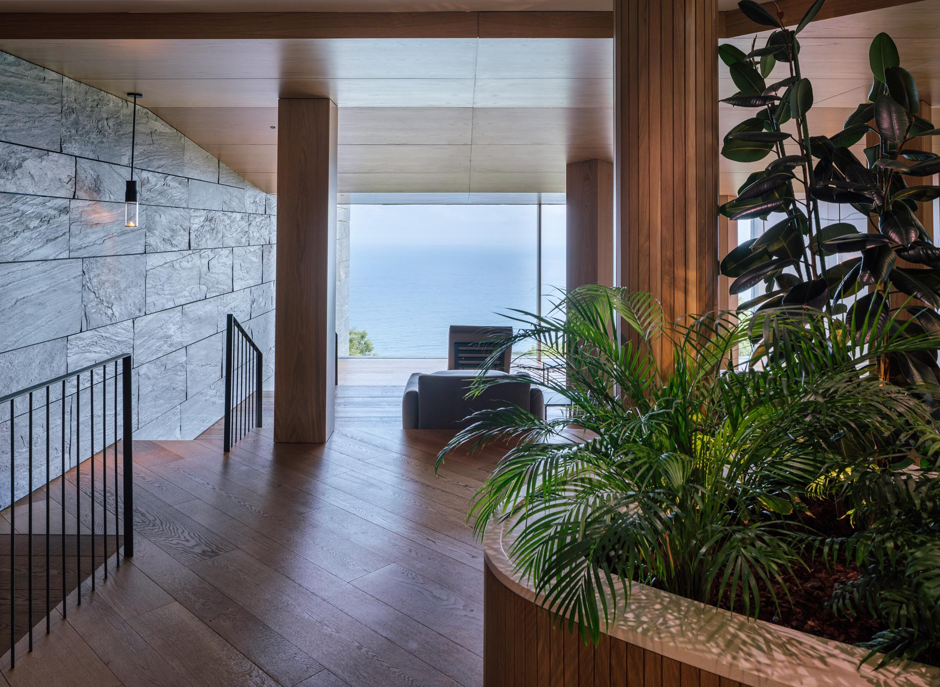 A modern spa with built-in planters.