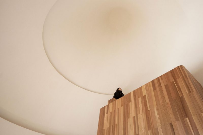 A modern cabin with a cone-shaped ceiling.