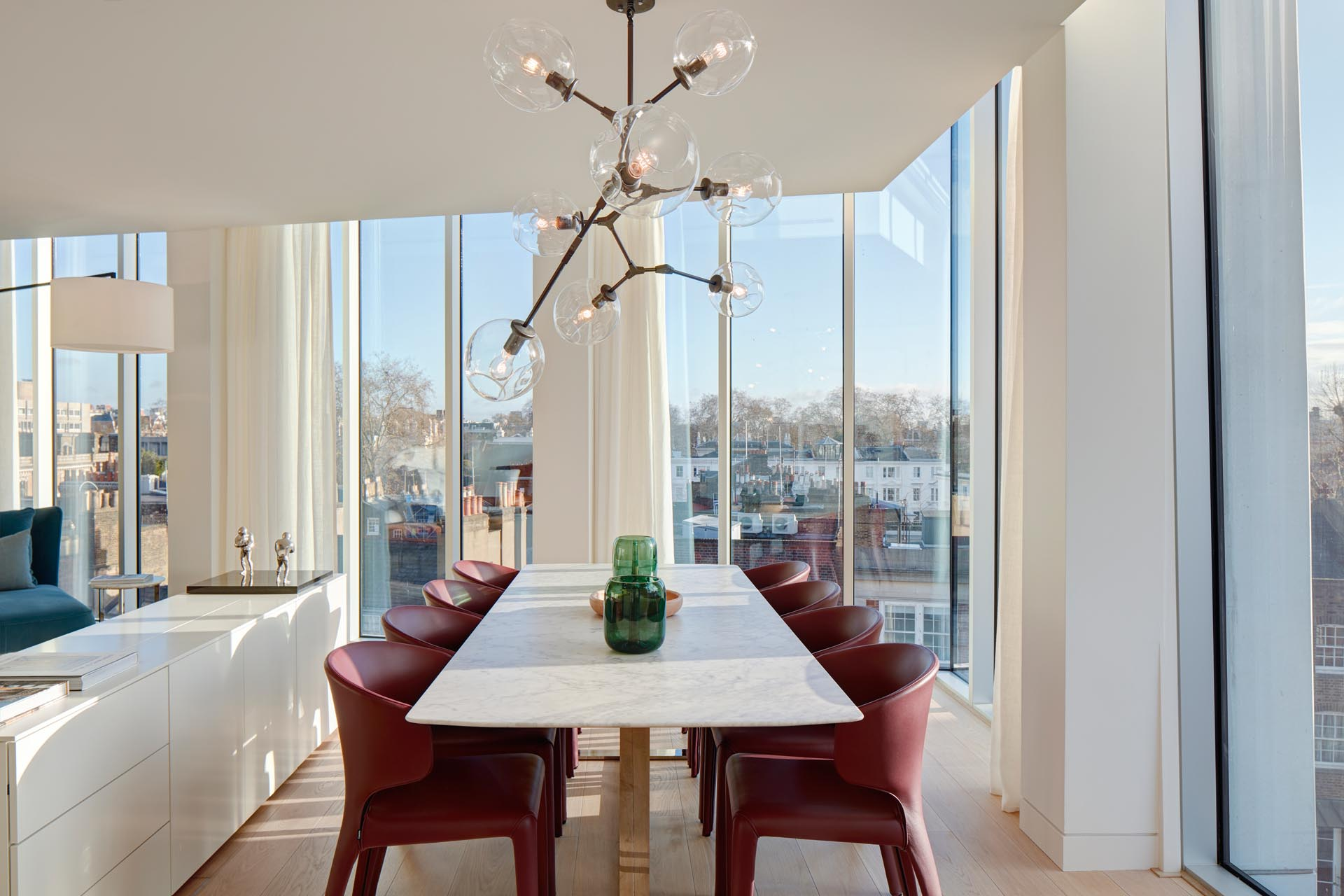A modern open plan dining area with floor-to-ceiling windows.