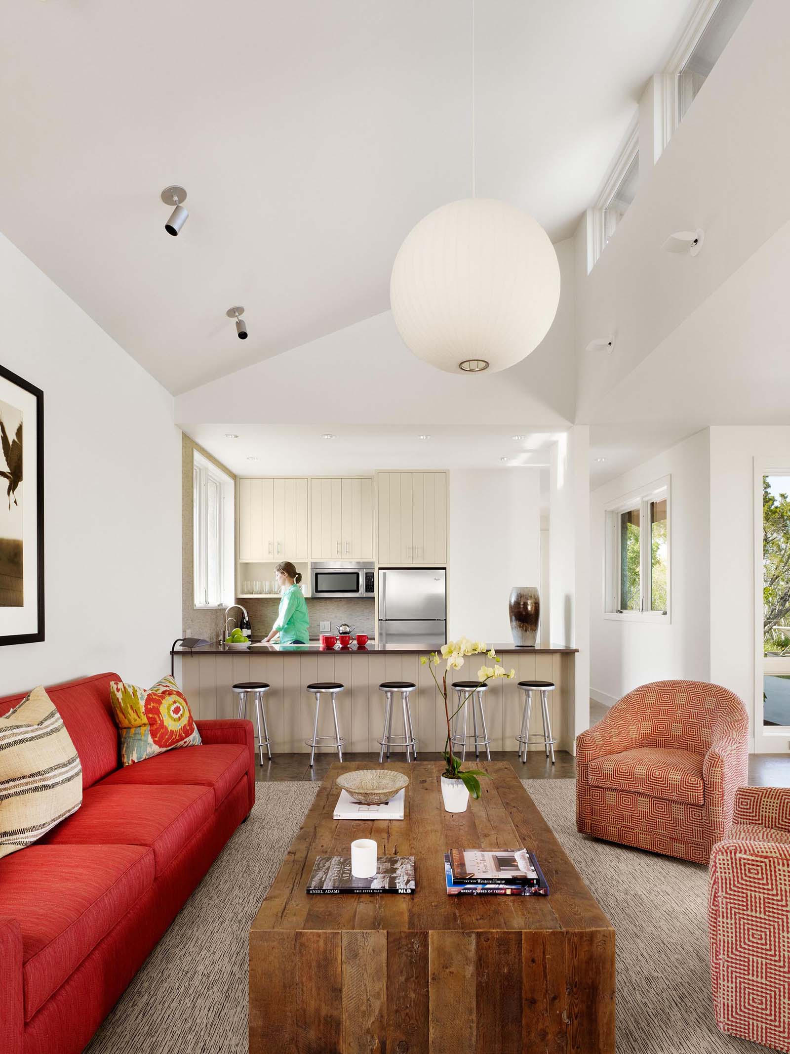 A contemporary guest house with open plan living room and kitchen.