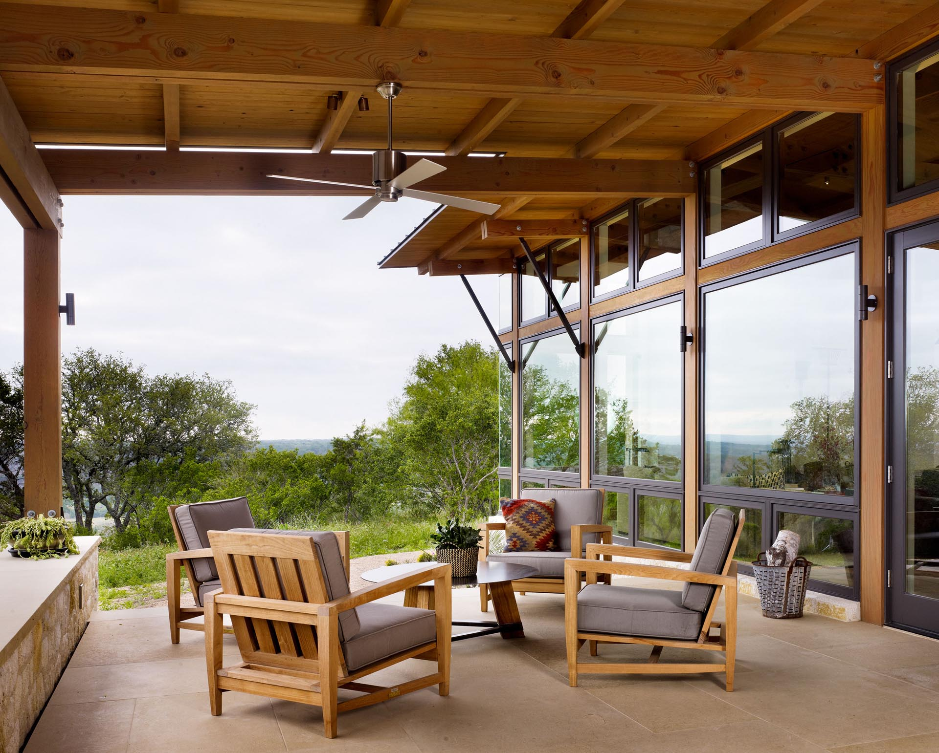 A covered porch with exposed wood beams.