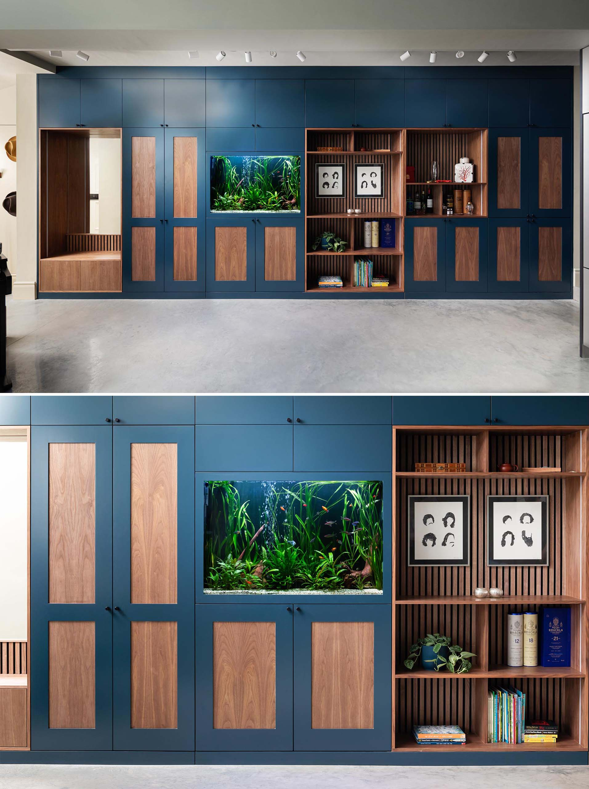 An entire wall of dark blue and wood cabinetry that includes a bench with a mirror, plenty of storage, a fish tank, open shelving, and an integrated coffee station.