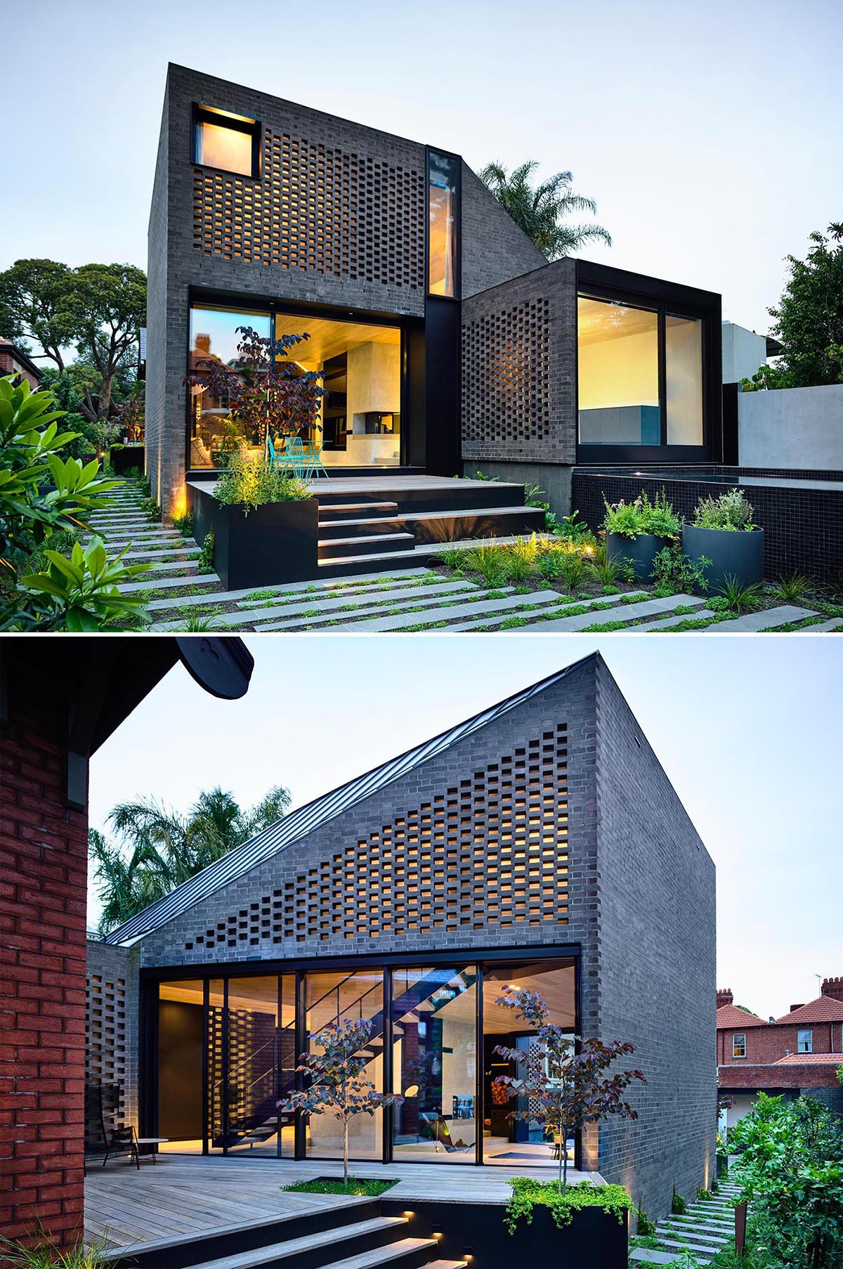 A modern dark brick house addition  with a swimming pool and landscaped path.