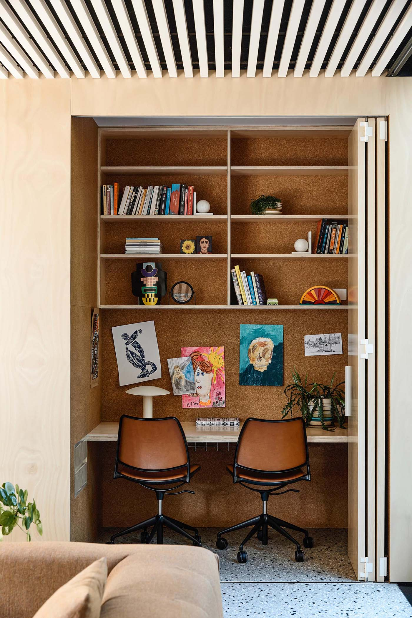 This modern home has a small home office / homework station that's been tucked within a closet, making it easily accessible, and at the same time, can be hidden from when not in use.