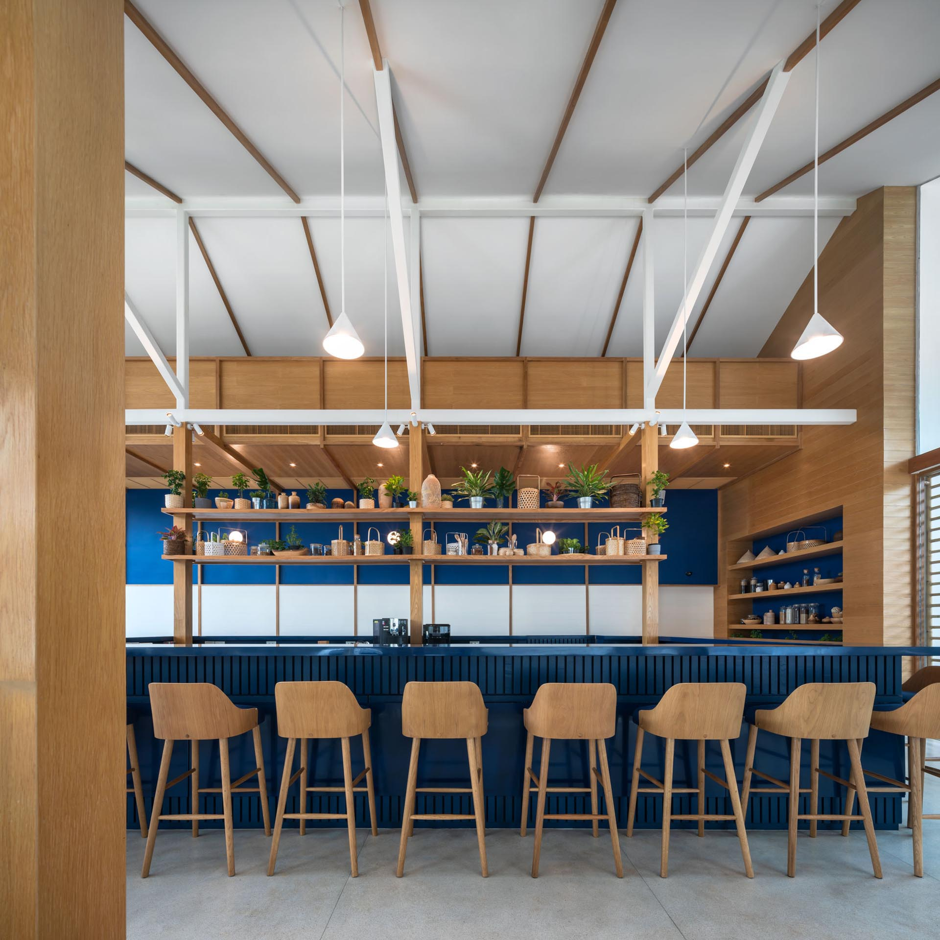 A modern hotel restaurant with blue, white, and wood color scheme.