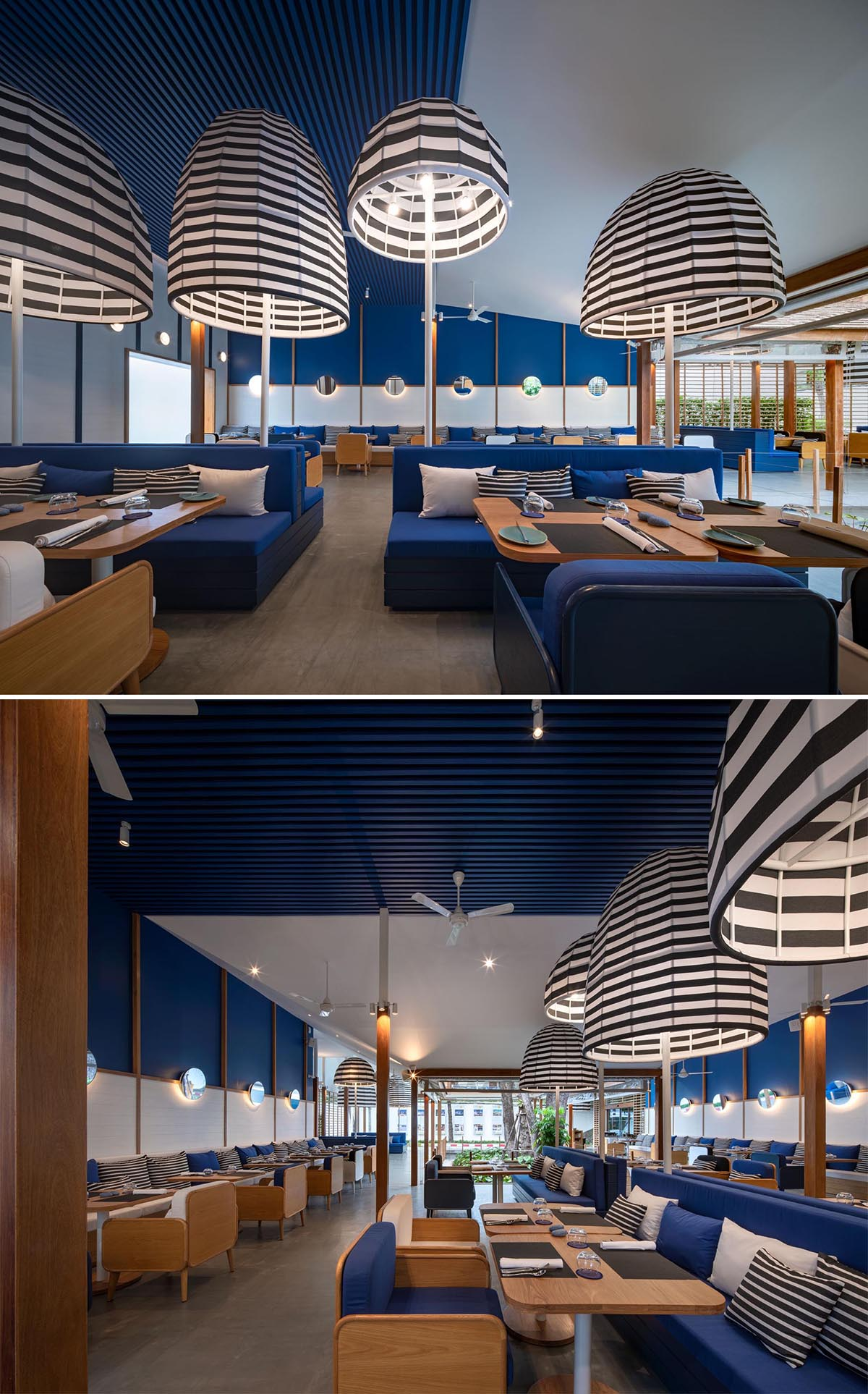 A modern hotel restaurant with a blue and white theme, as well as black and white striped accents.