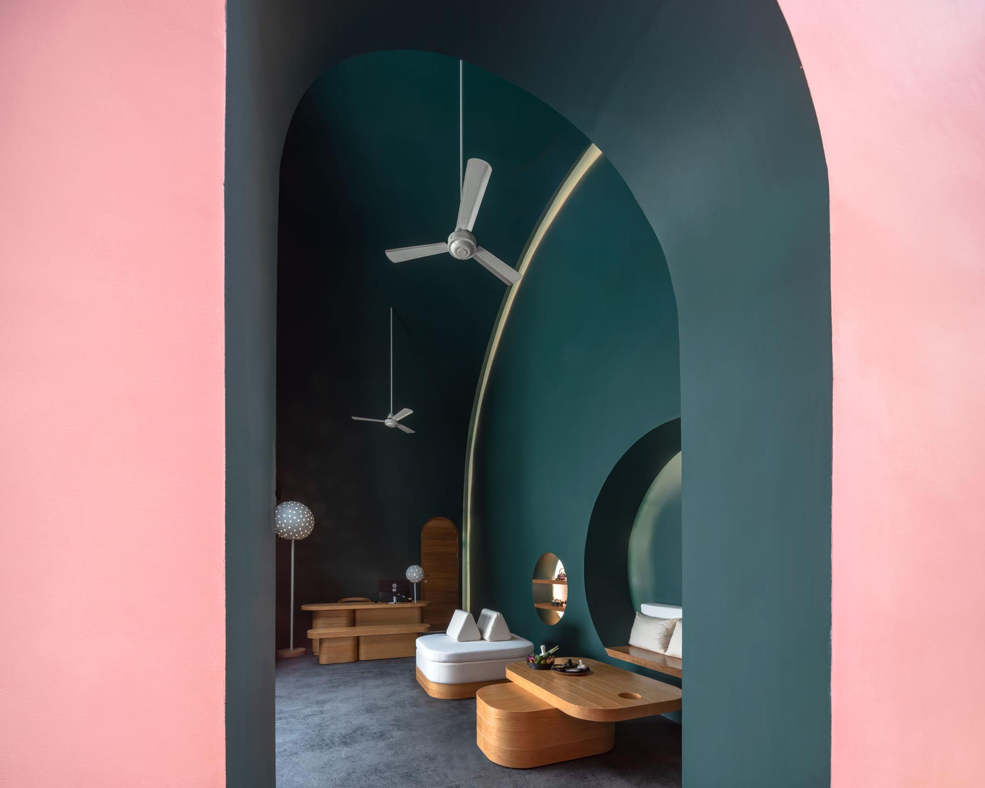Dark green and light pink walls in a hotel spa.