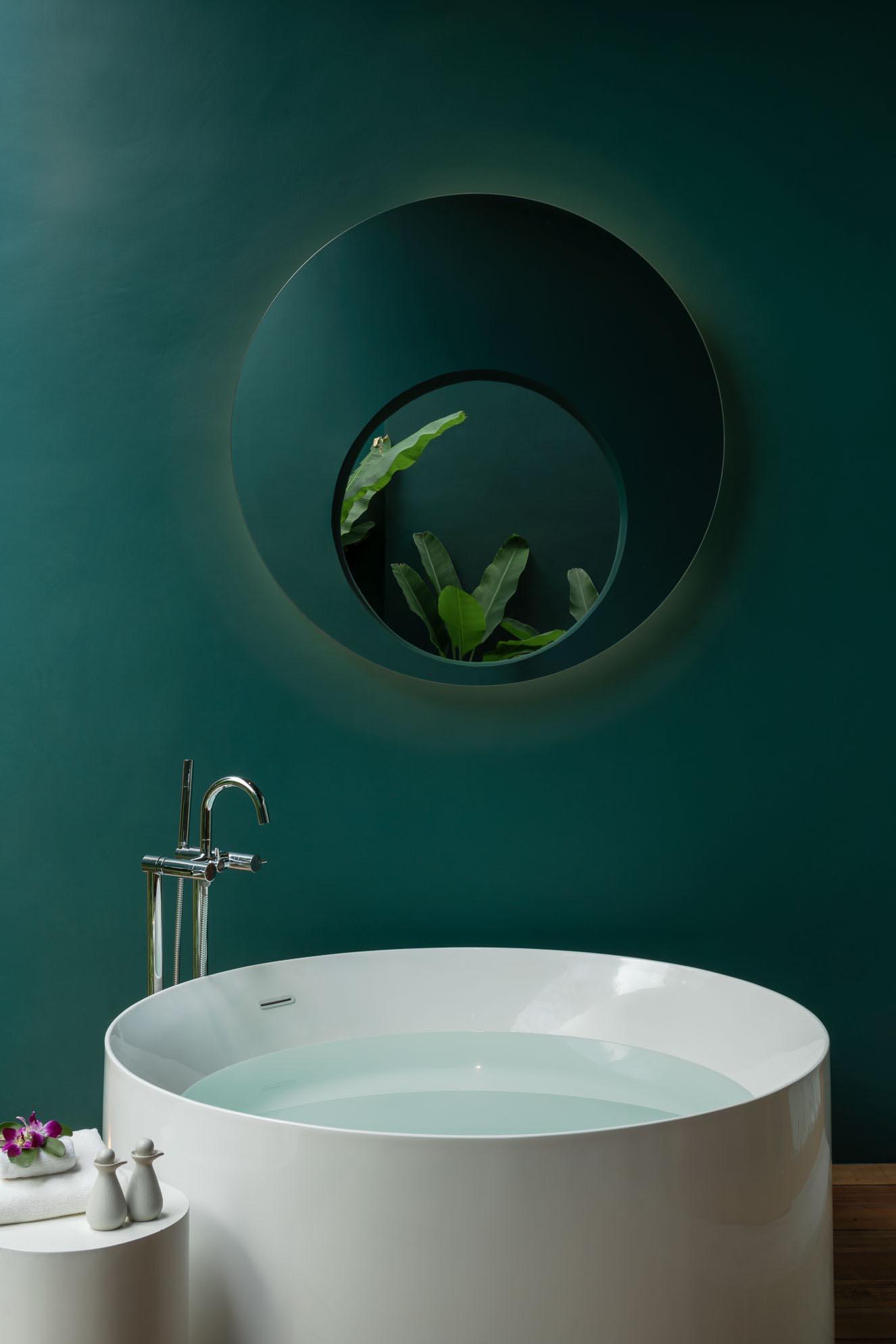 A bathroom with deep green walls.