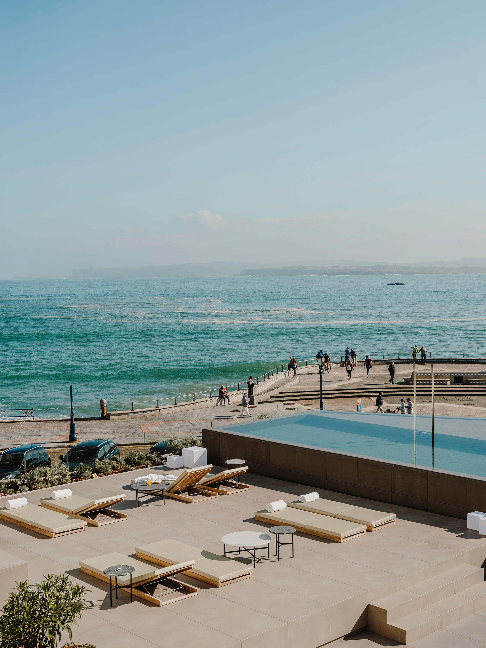 A modern hotel in Spain with a variety of levels dedicated to outdoor spaces and an infinity edge swimming pool.