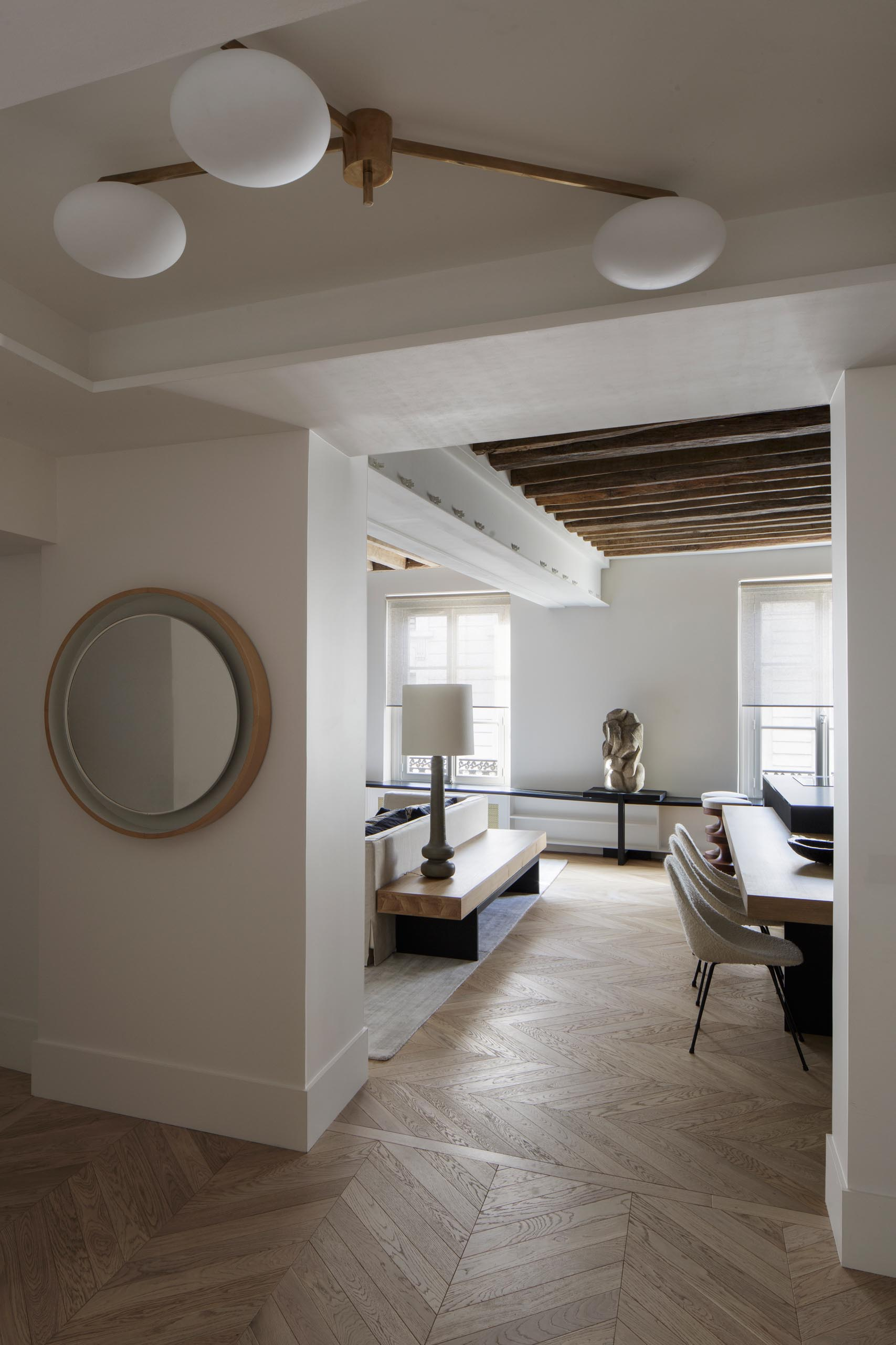 A modern entryway with light wood floors that flow through to the living room and kitchen.