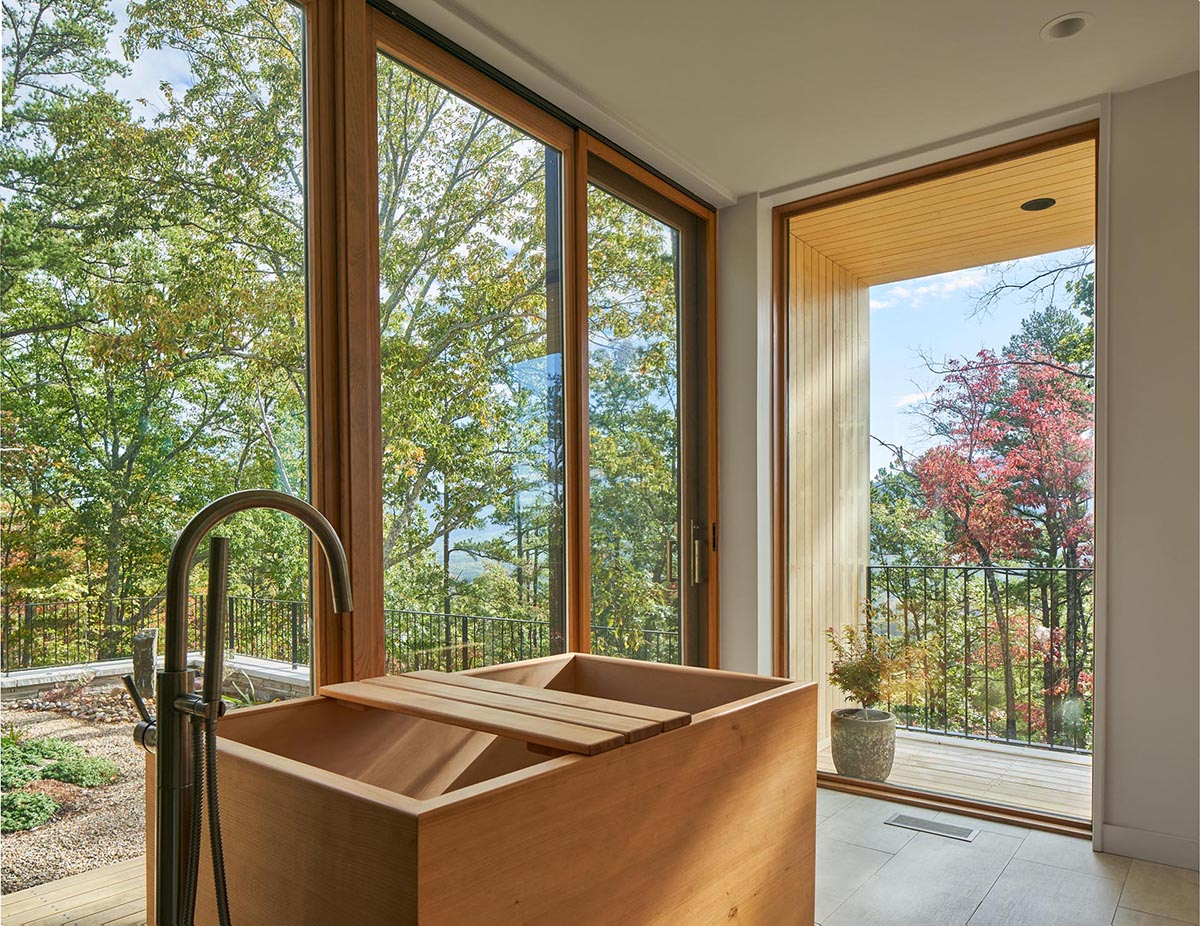 A modern bathroom with a wood Japanese soaking tub.