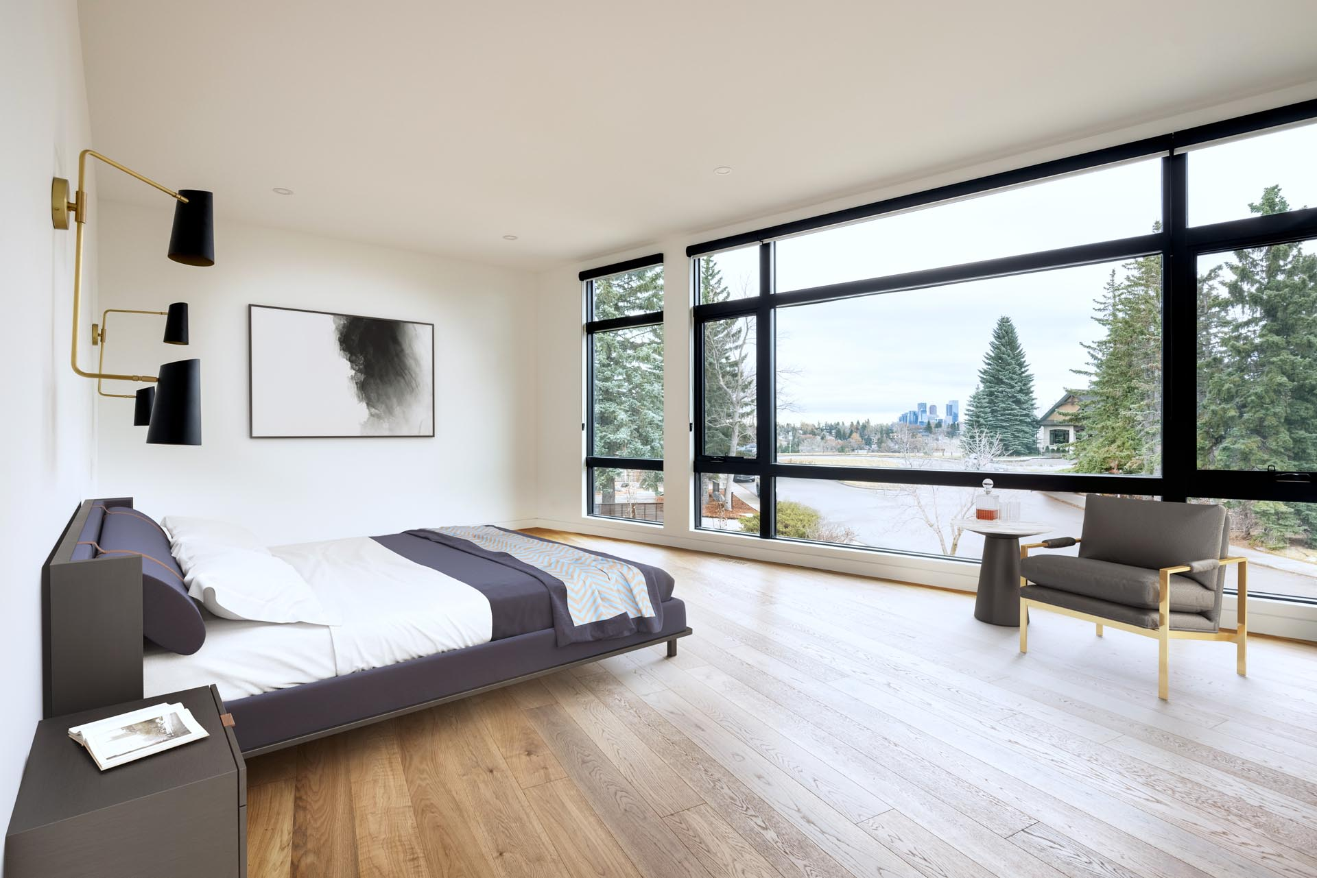 In this primary bedroom, bronze and black lighting has been mounted to the wall on either side of the bed, while the windows provide views of the neighborhood.