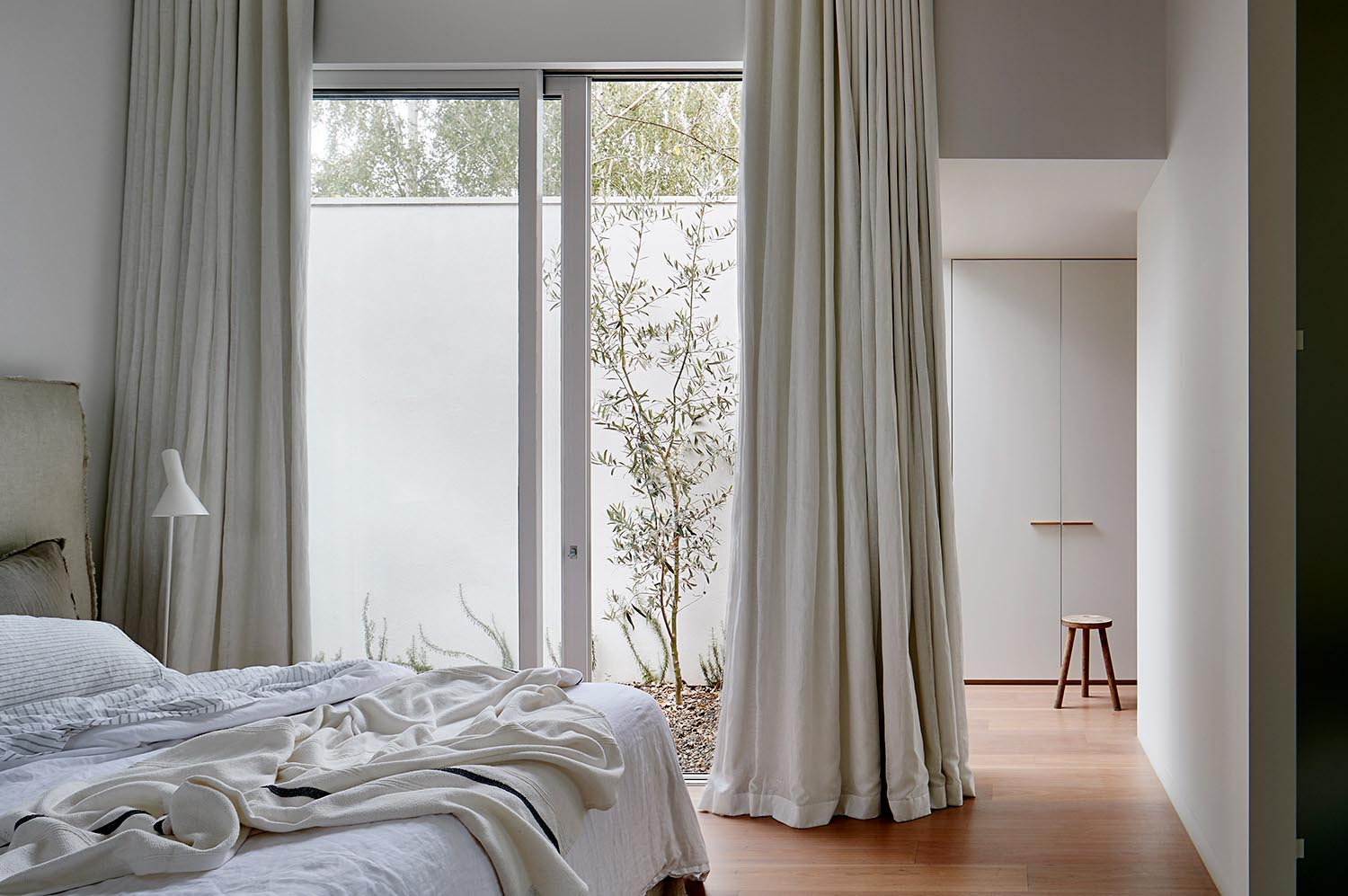 A modern bedroom with a natural color palette.