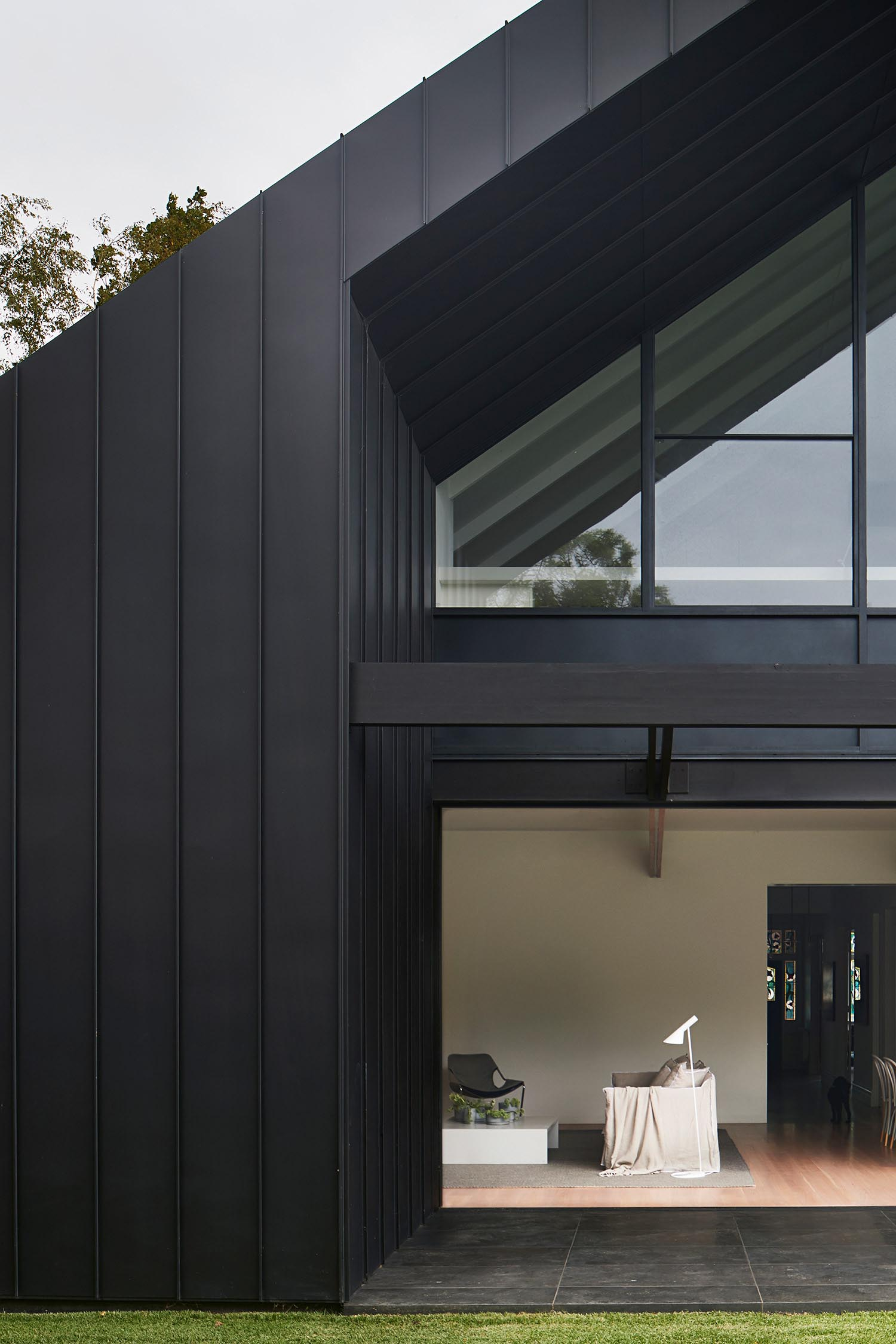 A modern black house addition.