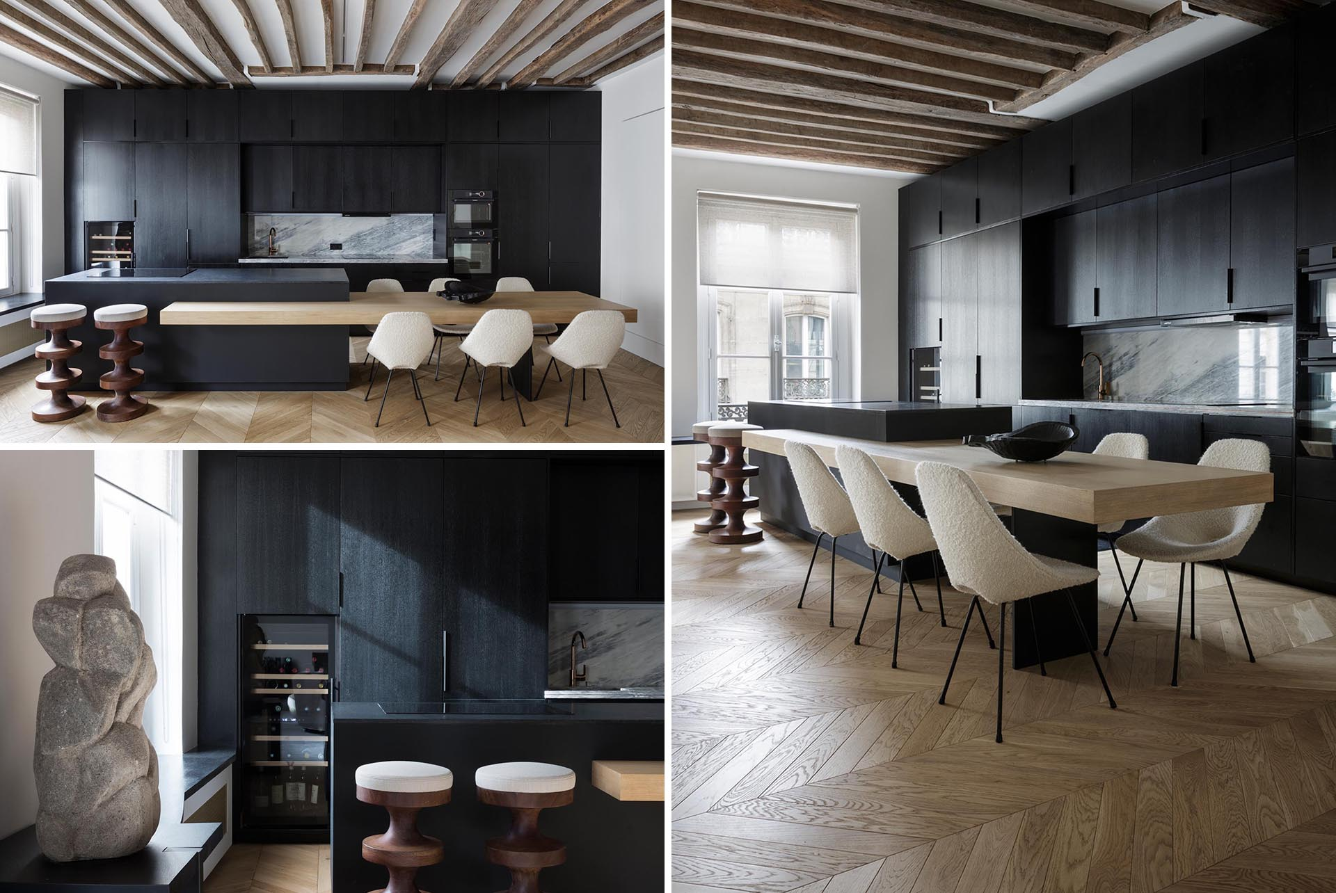 A modern apartment with a matte black kitchen and built-in dining table.