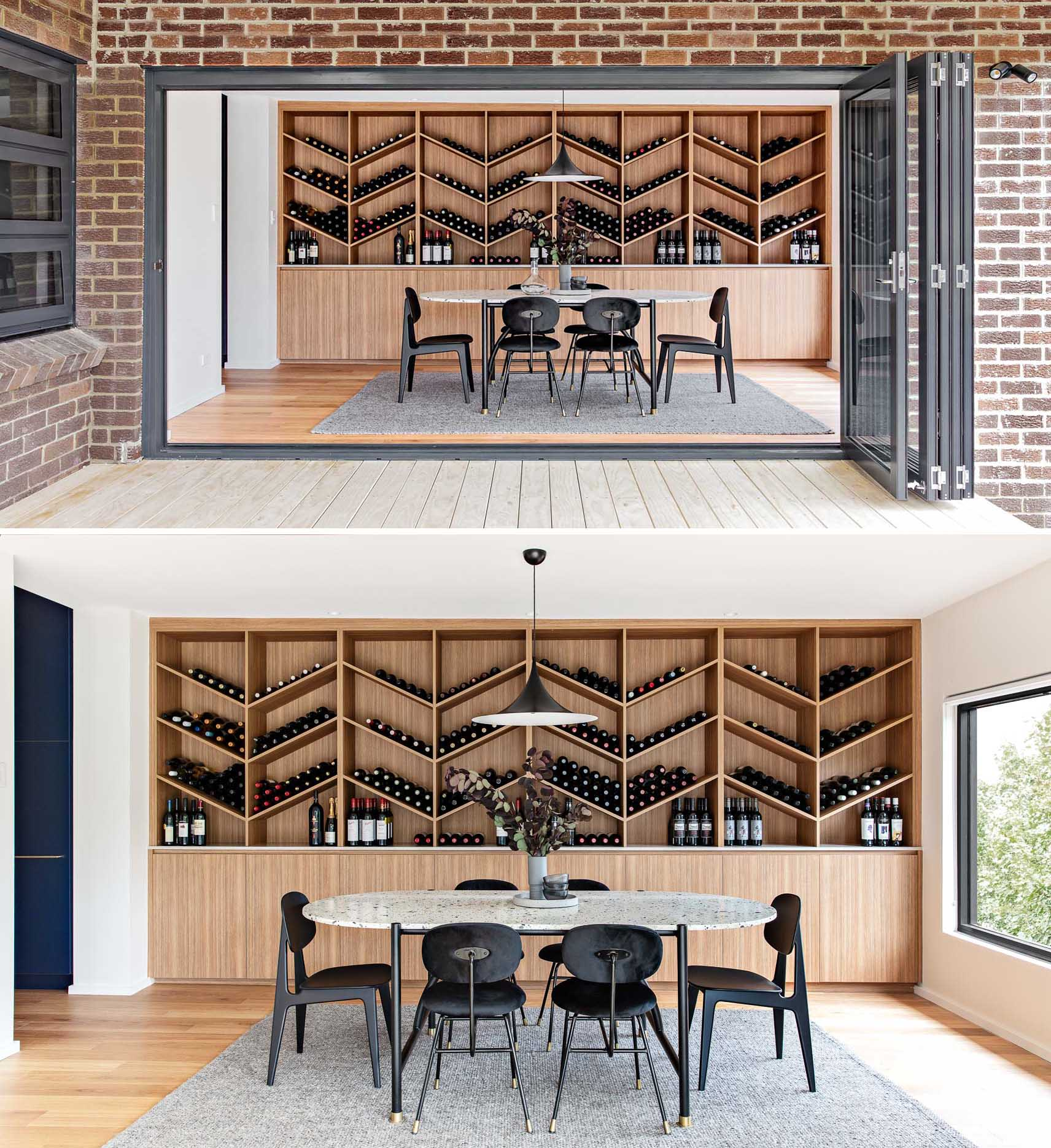The wine storage wall, which is made from wood, includes lower cabinets, a countertop, and a shelving unit with a chevron design.