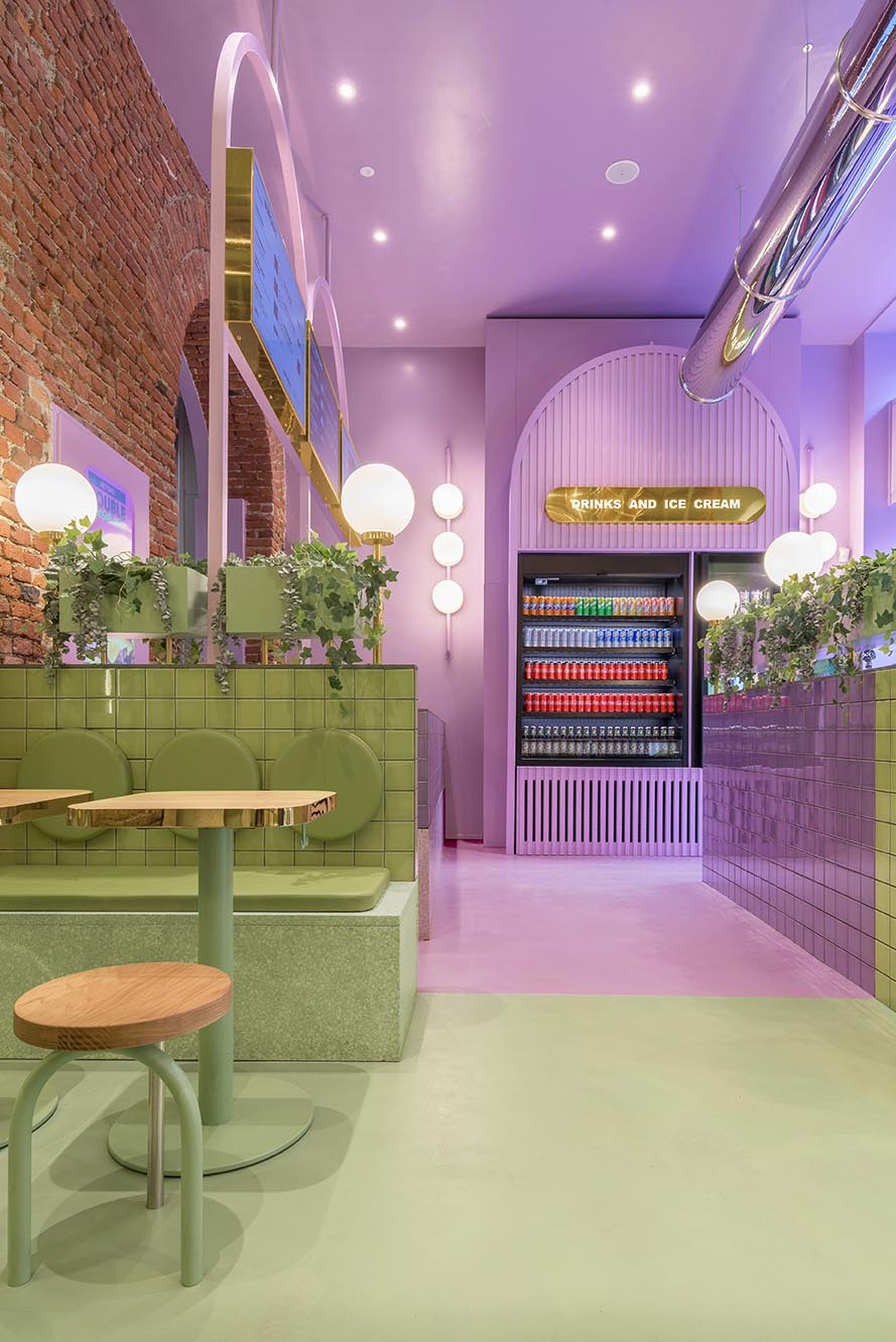 A new restaurant uses a colorful green and purple interior to draw people inside.