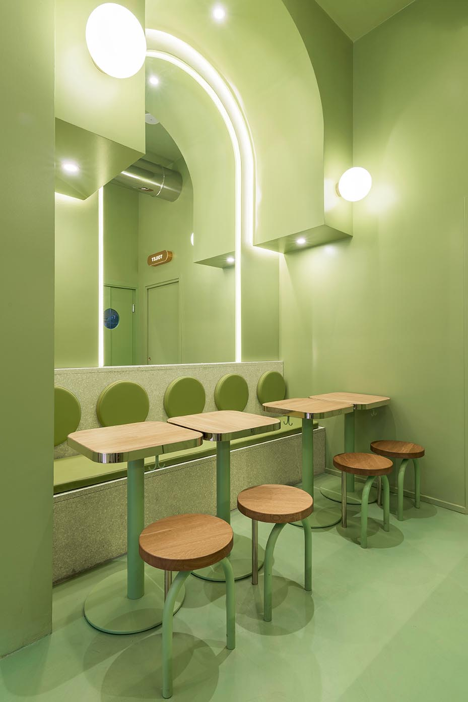 A new restaurant in Milan, Italy, uses a colorful green interior design to draw people inside.