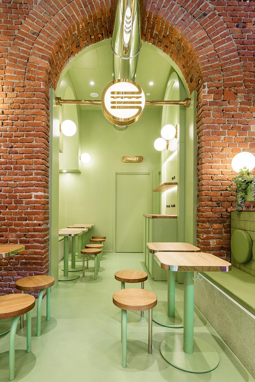 A new restaurant uses a colorful green interior to draw people inside.