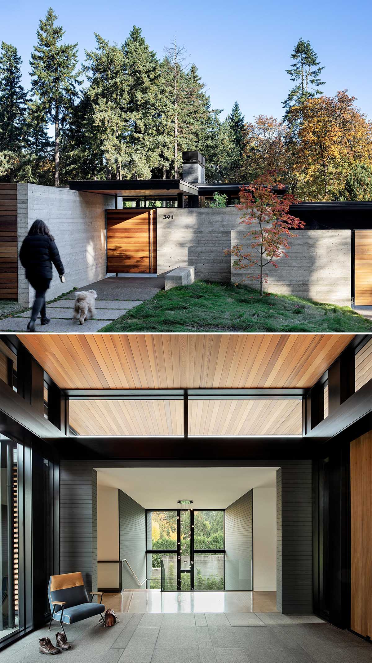 A modern home with a concrete wall and wood front door.