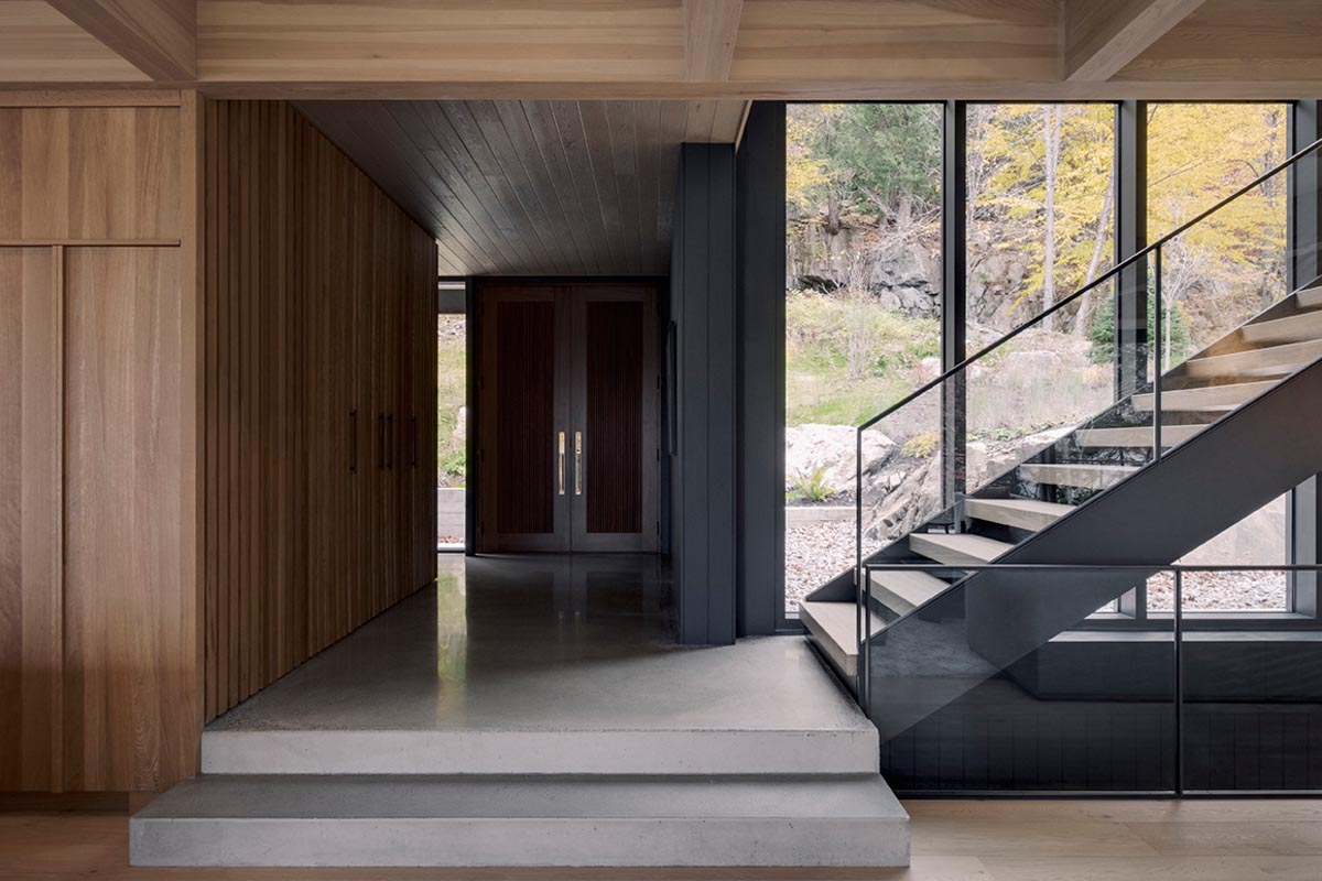Stepping inside the home and there's polished concrete flooring and warm wood details.