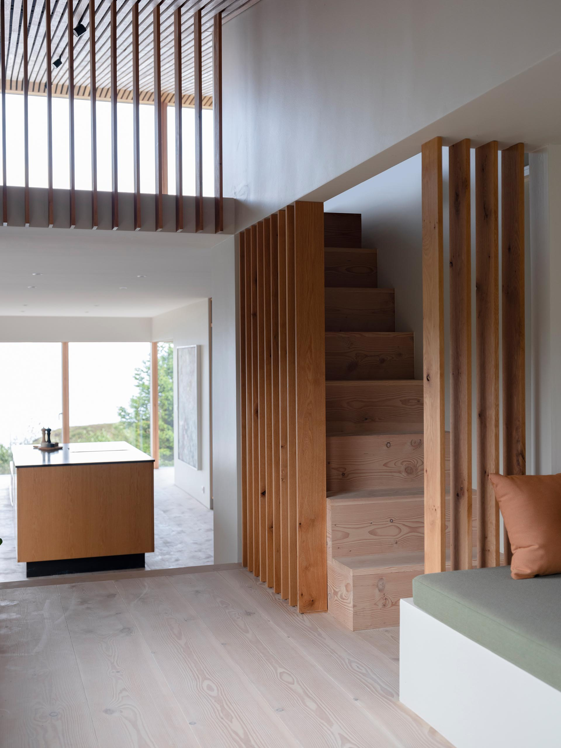 A modern home with wood floors and stairs.