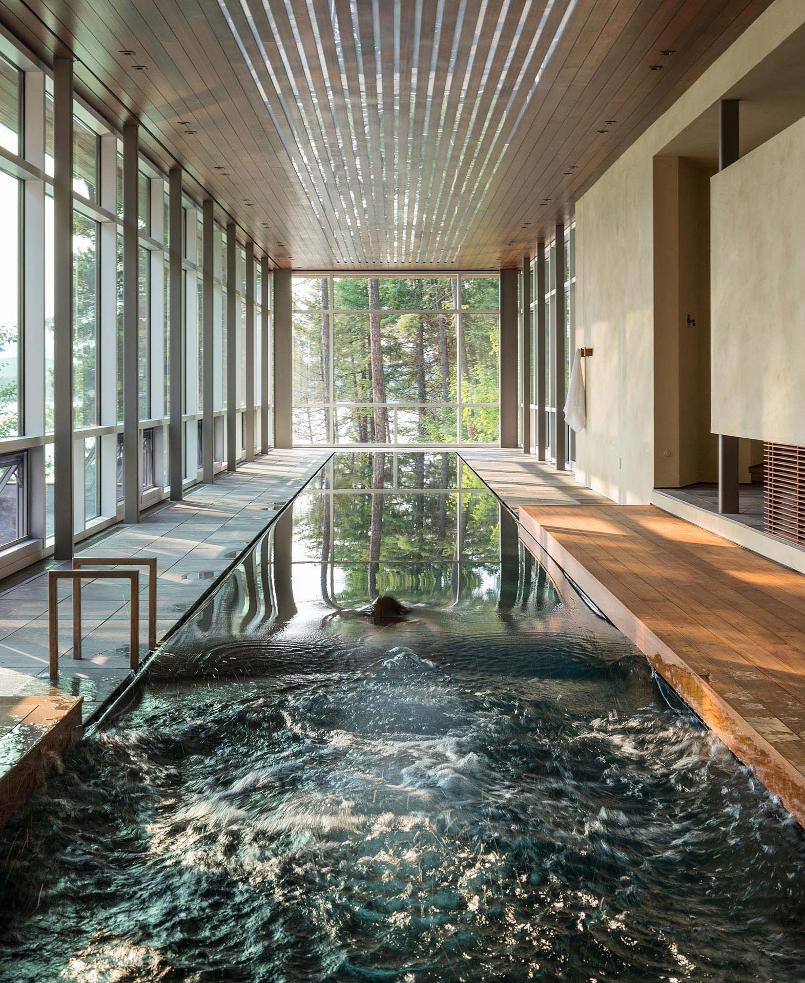 A 75-foot-long, single-lane lap pool is naturally lit by the floor to ceiling windows during the day.