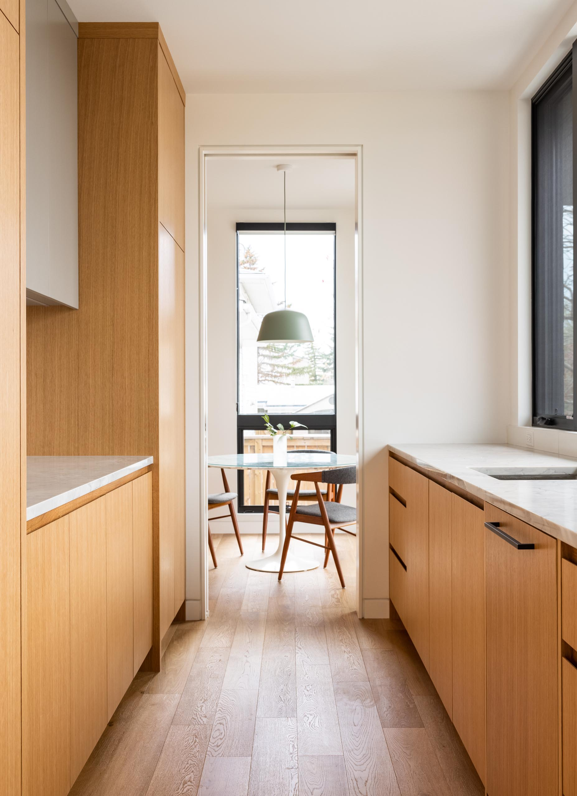A small breakfast area is located off the kitchen, while a walk-through pantry connects with the main dining room.