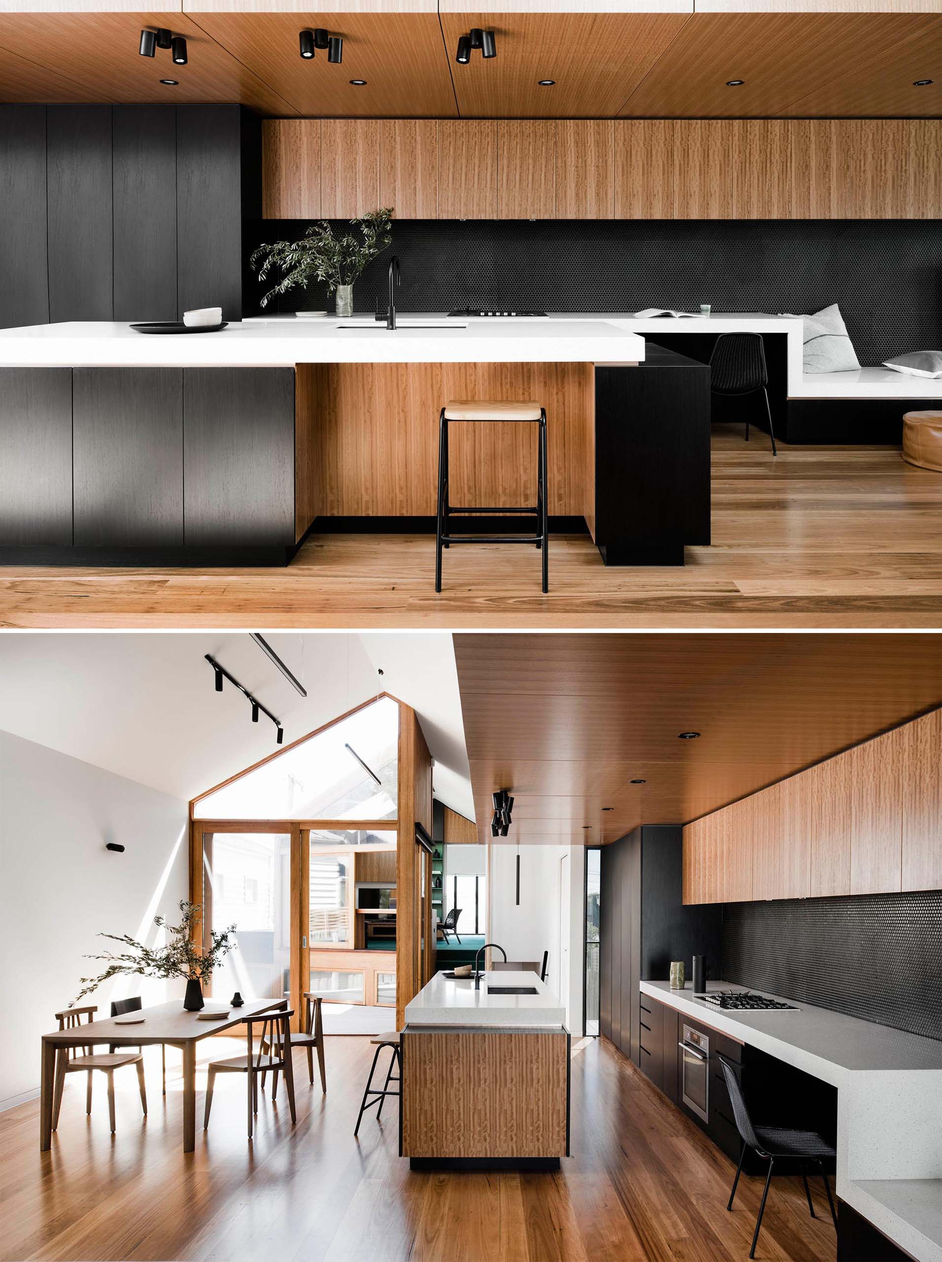 A modern kitchen with black cabinets and wood accents, has a white countertop that transforms into a desk, TV stand, and window bench.