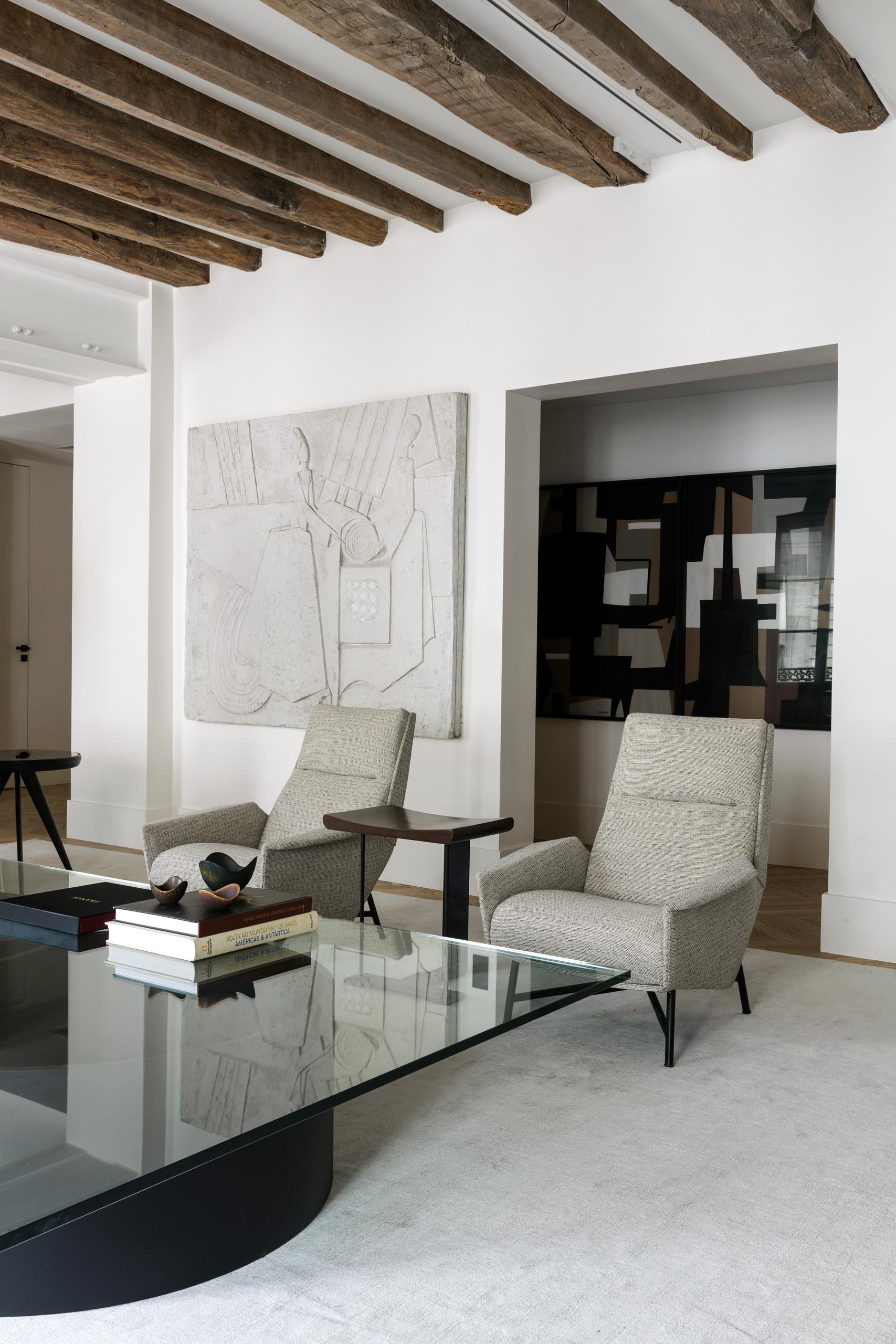 In this modern living room, neutral colored furniture creates a calm and relaxed environment.