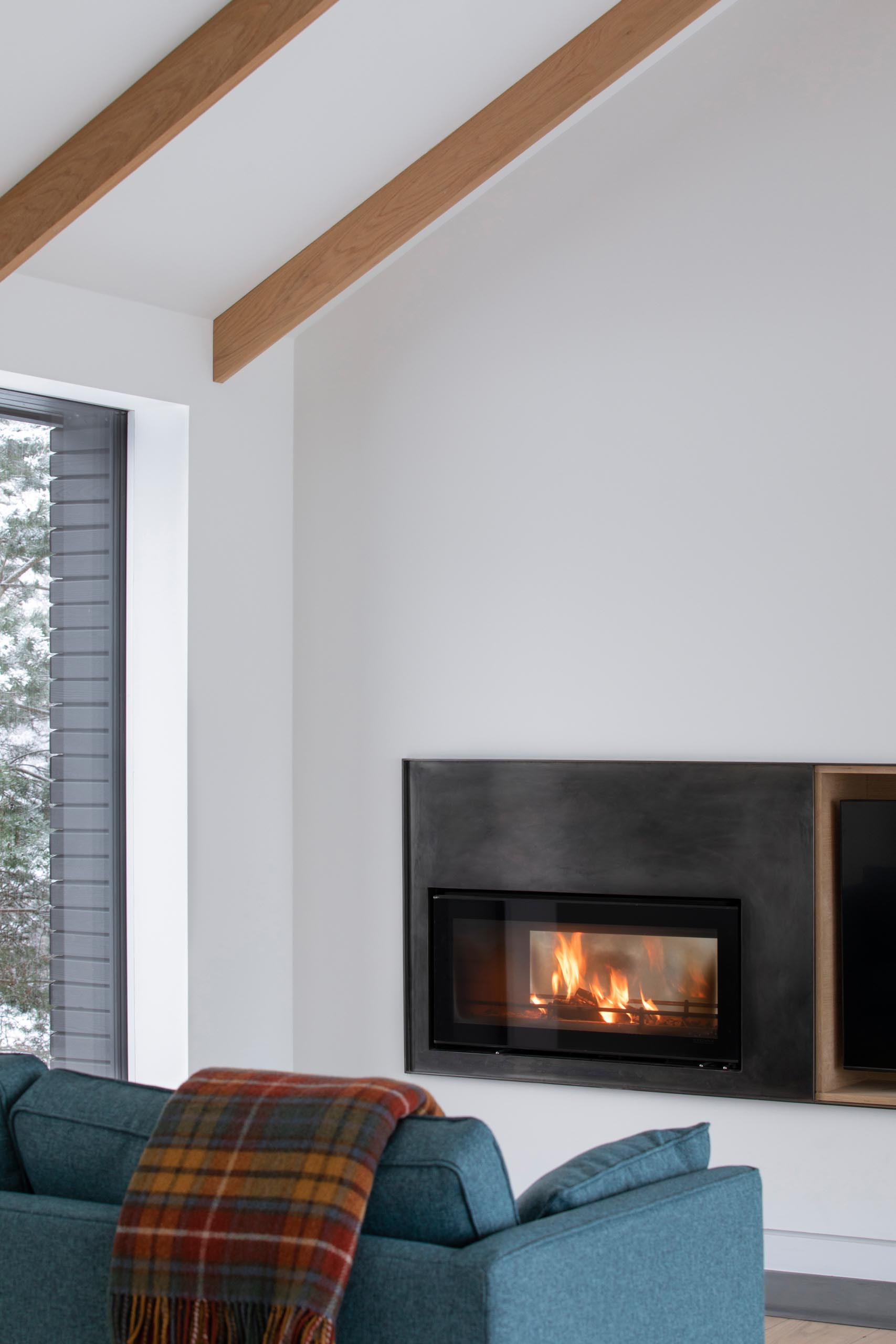 A modern living room with a steel fireplace surround.